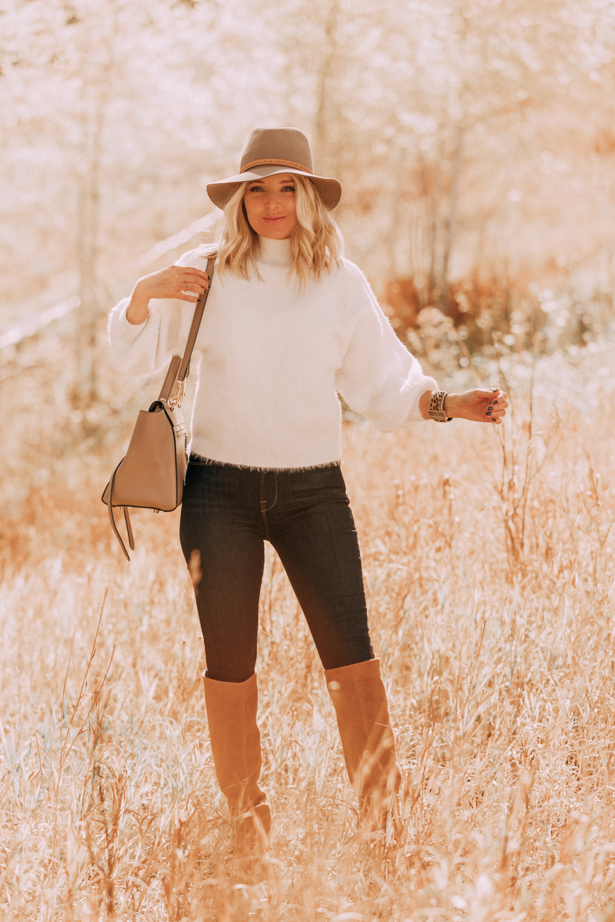 Rag & Bone fedora hat paired with white fuzzy sweater and dark wash jeans on fashion blogger over 40 Erin Busbee of Busbee Style