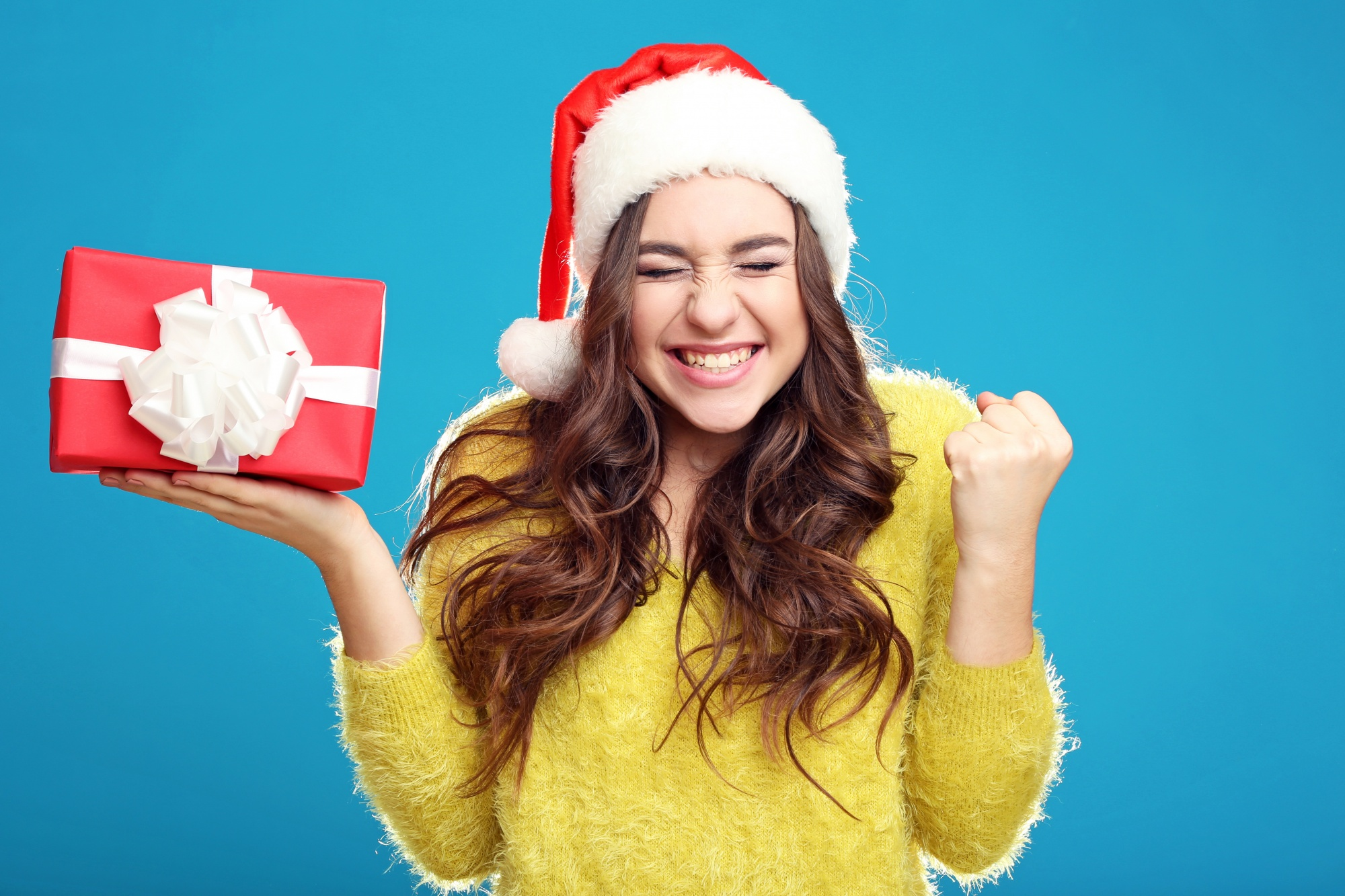 Holiday Gifts for Teens, excited teenage girl holding gift