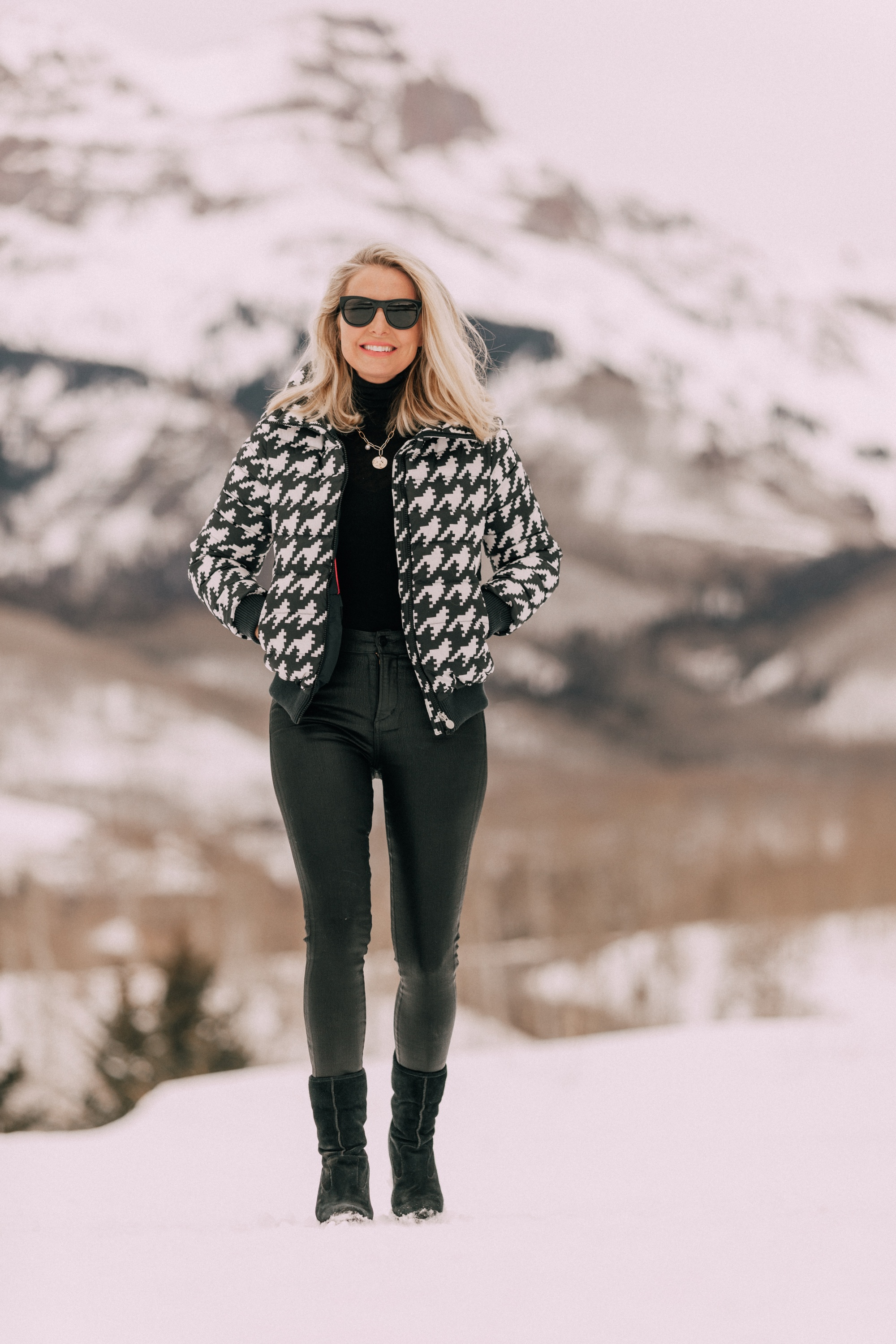 Chic Puffers, Fashion blogger Erin Busbee of BusbeeStyle.com wearing black Rocket leatherette Skinny Jeans by Citizens of Humanity with a black cashmere turtleneck sweater by Aqua, and a houndstooth puffer jacket by Perfect Moment from Shopbop in the snow in Telluride, CO