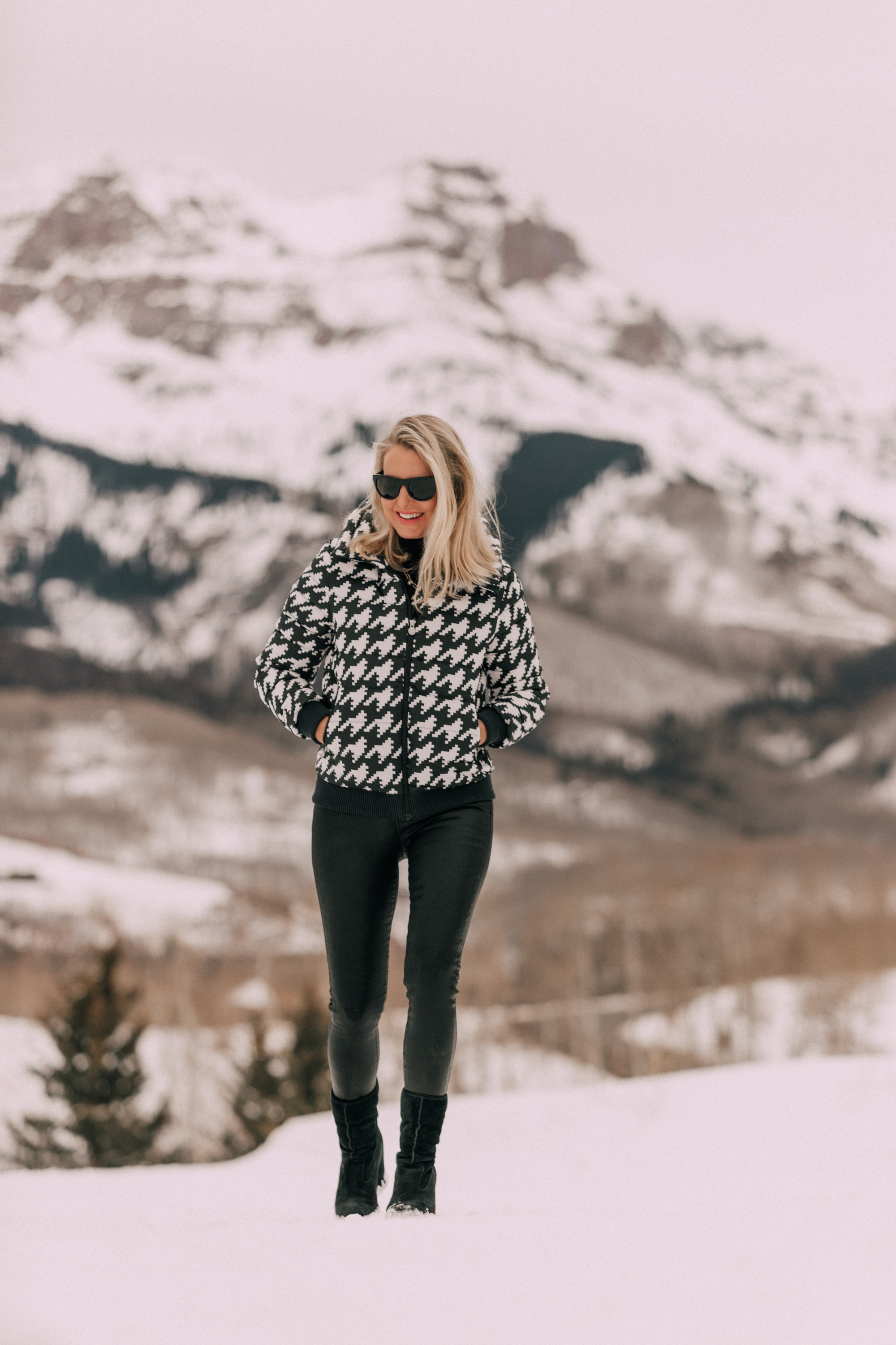 Chic Puffers, Fashion blogger Erin Busbee of BusbeeStyle.com wearing black Rocket leatherette Skinny Jeans by Citizens of Humanity with a black cashmere turtleneck sweater by Aqua, and a houndstooth puffer jacket by Perfect Moment from Shopbop, and Ugg wedge boots in the snow in Telluride, CO