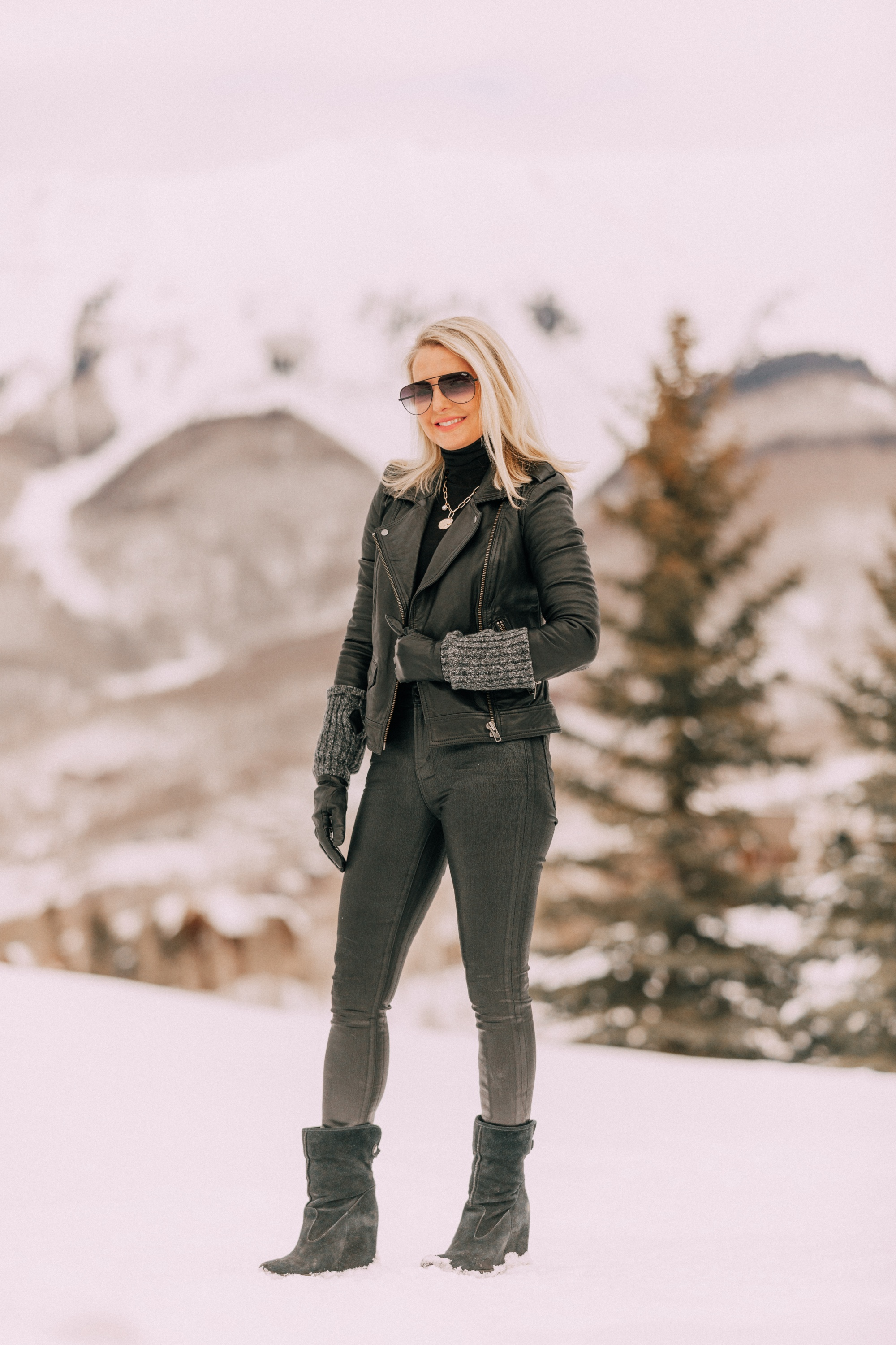 layered Moto Jacket outfit on Fashion blogger wearing a black leather IRO moto jacket, Carolina Amato gloves, rocket leatherette skinny jeans by Citizens of Humanity, black cashmere turtleneck, and Ugg wedge boots in Telluride, CO