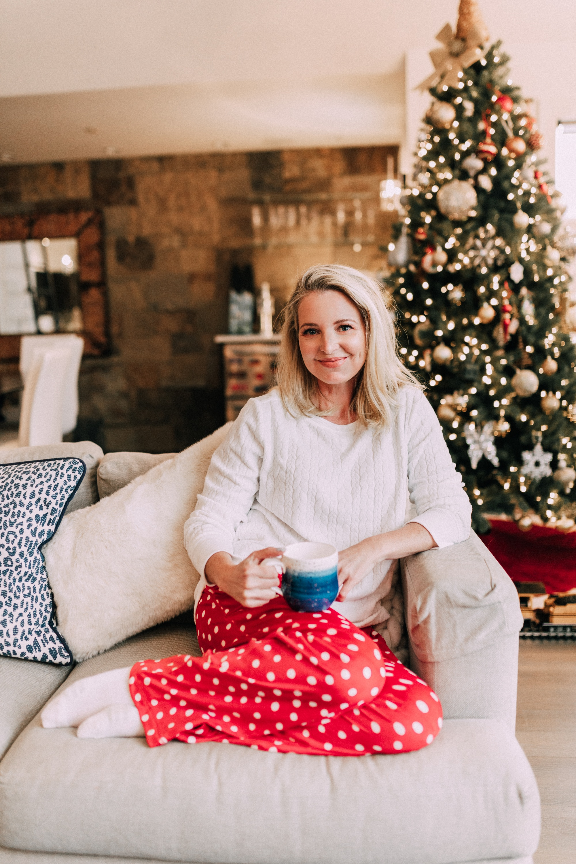 Holiday Traditions, Fashion blogger Erin Busbee of BusbeeStyle.com wearing red fleece polka dot pajama pants with a fleece cable knit pullover from Jockey in Telluride, CO