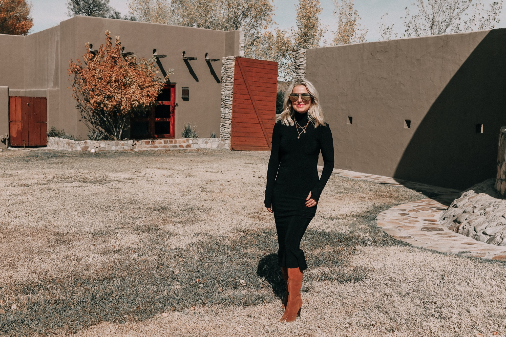 Sweater Dress, Fashion blogger Erin Busbee of BusbeeStyle.com wearing a black sweater dress by Norma Kamali with brown suede knee high boots by Vince Camuto in West Texas