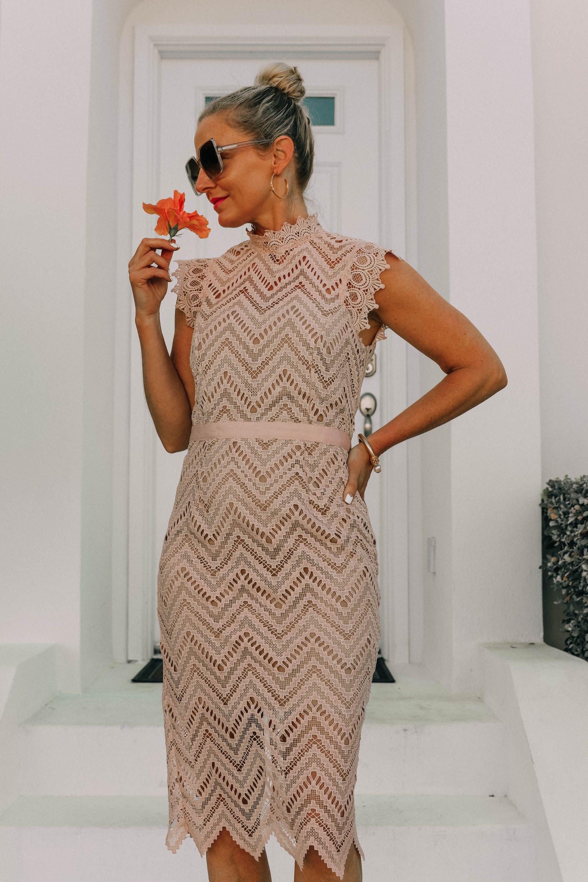 Mother's Day Dresses, Fashion blogger Erin Busbee of BusbeeStyle.com wearing a pink blush lace Bardot dress in the Bahamas styled with nude Valentino rockstud sandals and gold jewelry from Nordstrom