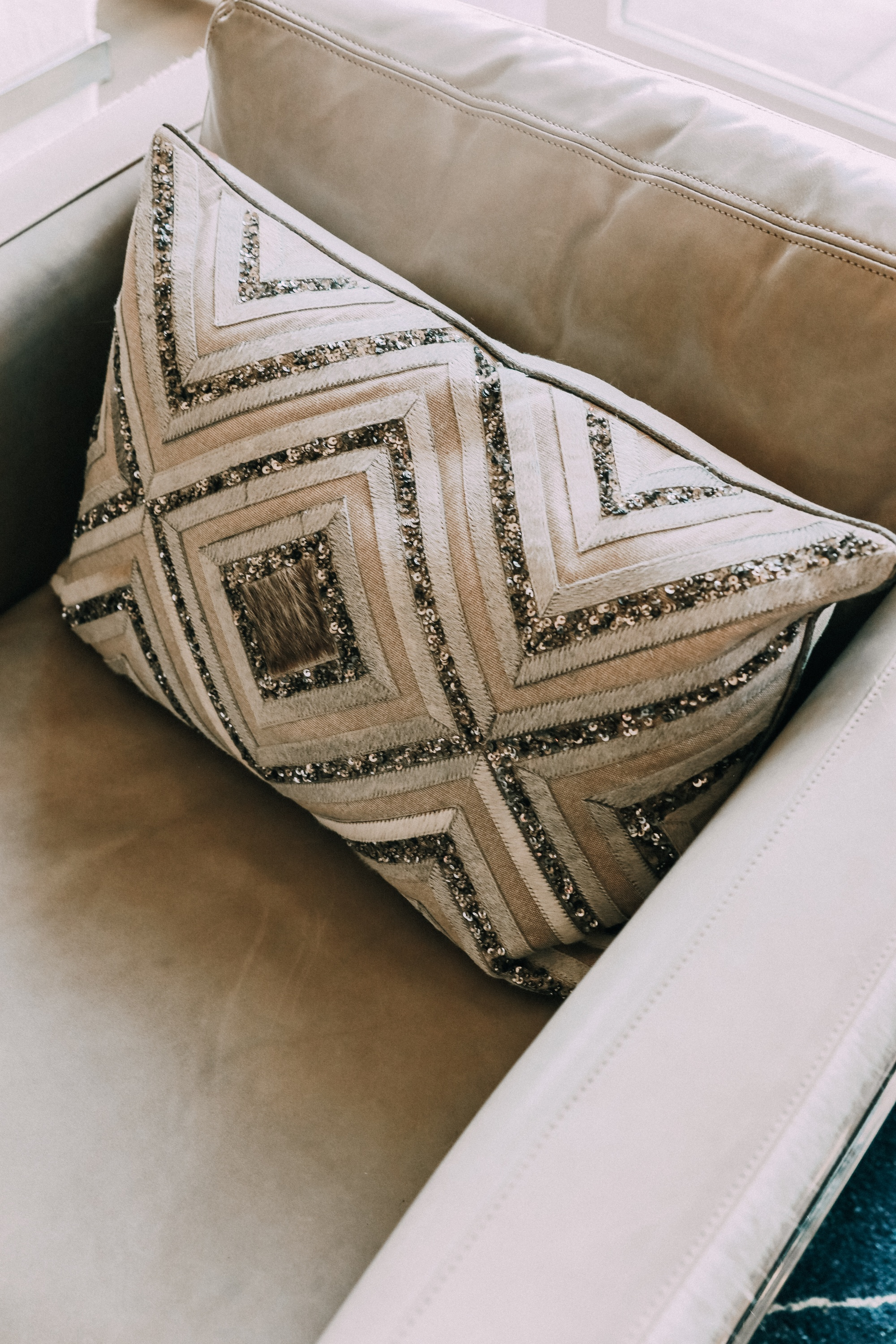 sequin throw pillow in chair