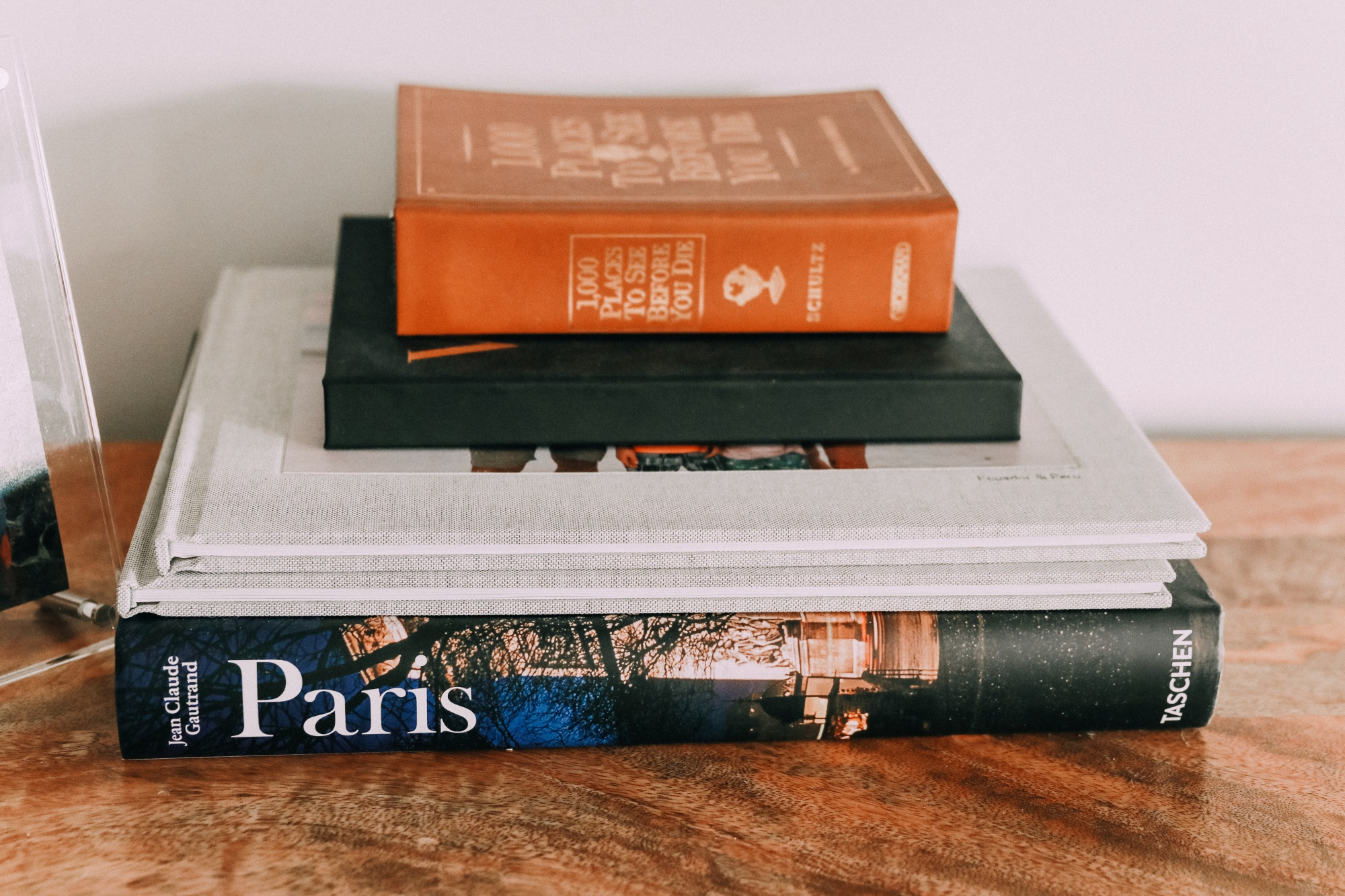 coffee table book stack on burl wood console table