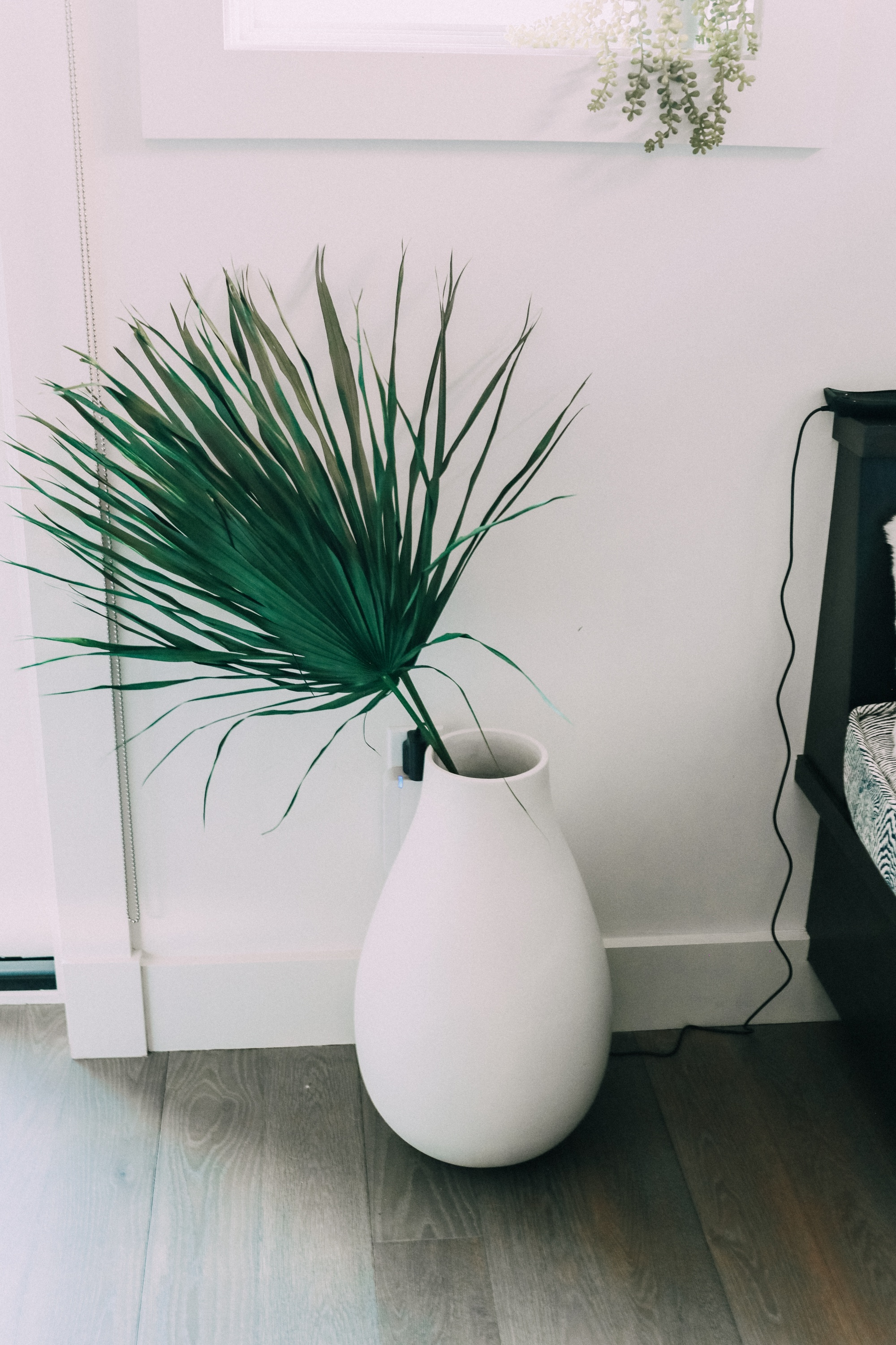 palm frond in vase on floor House Tour modern mountain townhome Telluride Colorado