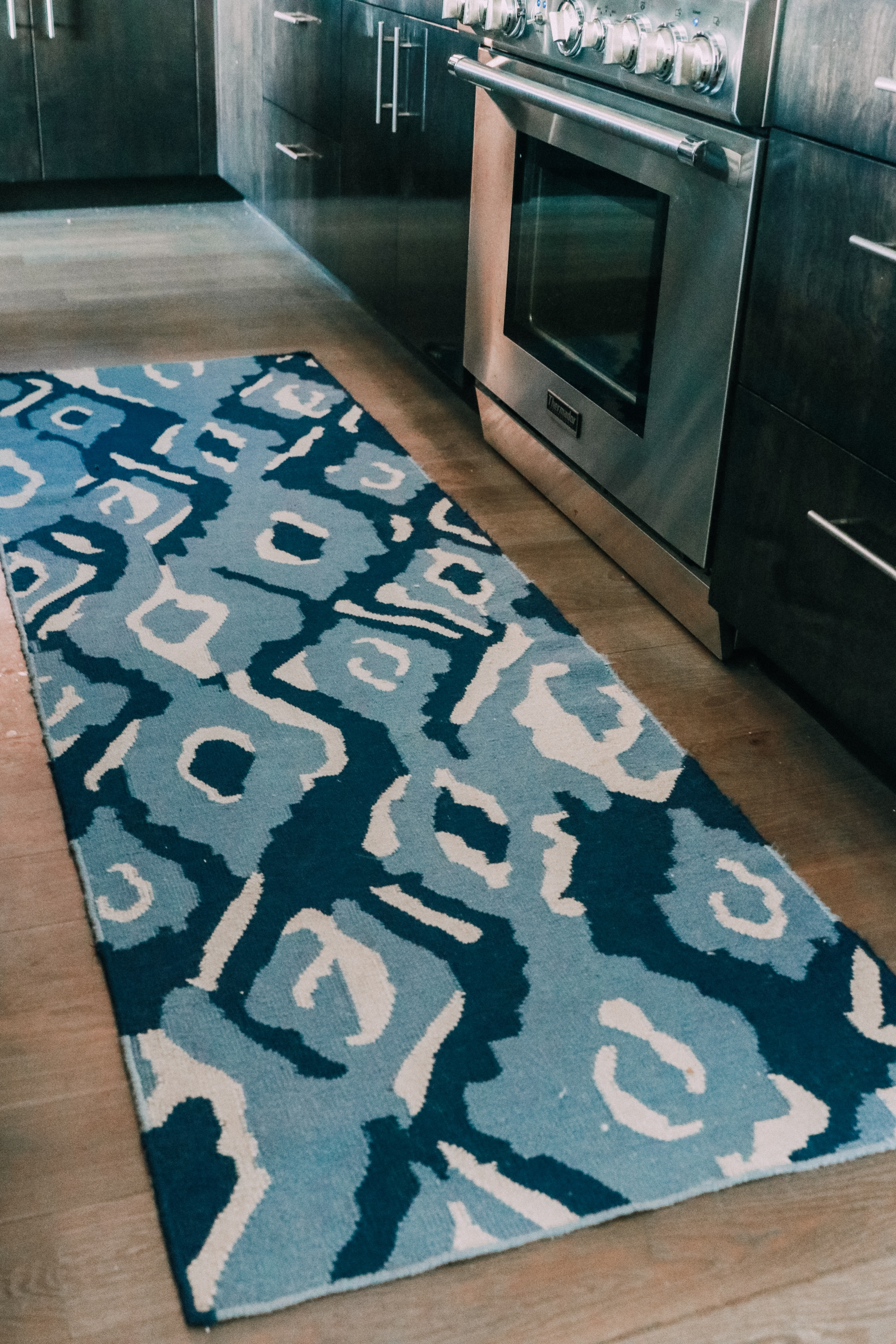 blue and white ikat kitchen rug runner by stove House Tour modern mountain townhome Telluride Colorado
