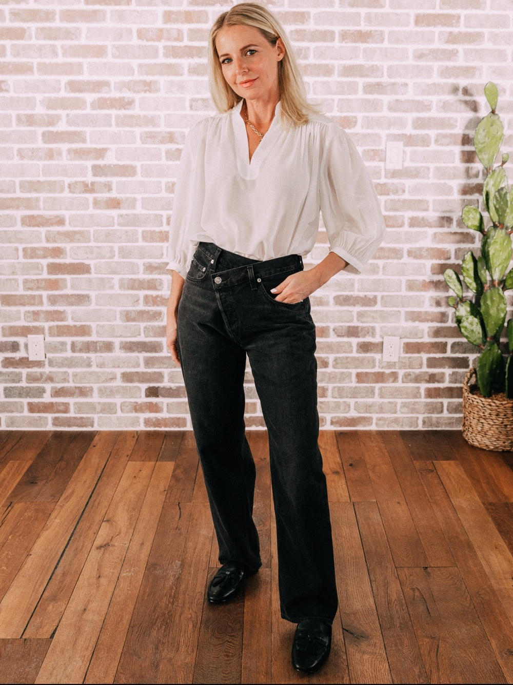 Stylish Work From Home Outfits, Fashion blogger Erin Busbee of BusbeeStyle.com wearing a white blouse by Frame with oversized black jeans by Agolde with asymmetrical button closure in Telluride, Colorado