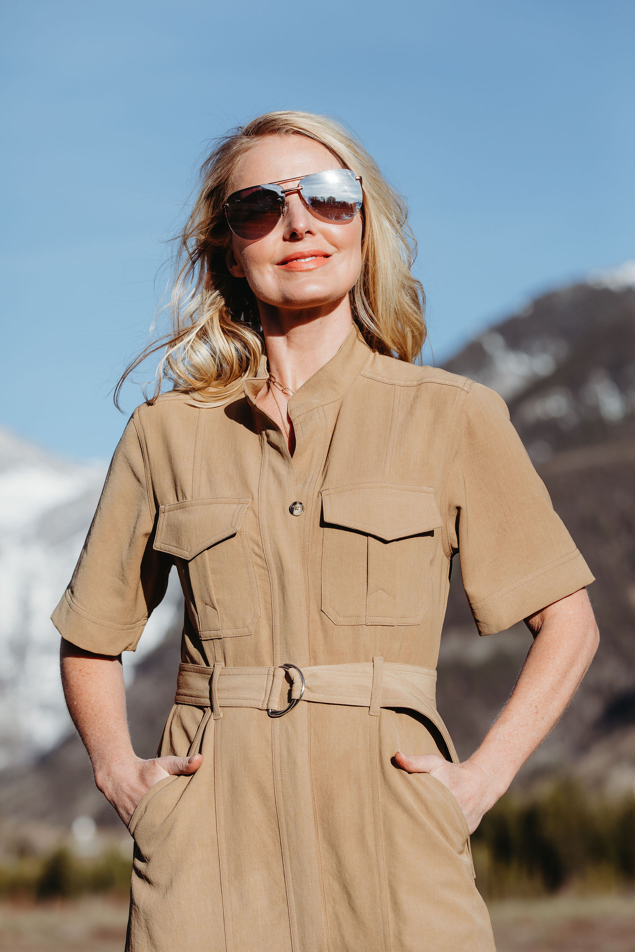 Africa Outfits, Erin Busbee of Busbee Style wearing a tan belted shirtdress by ALC with white booties in Telluride, Colorado