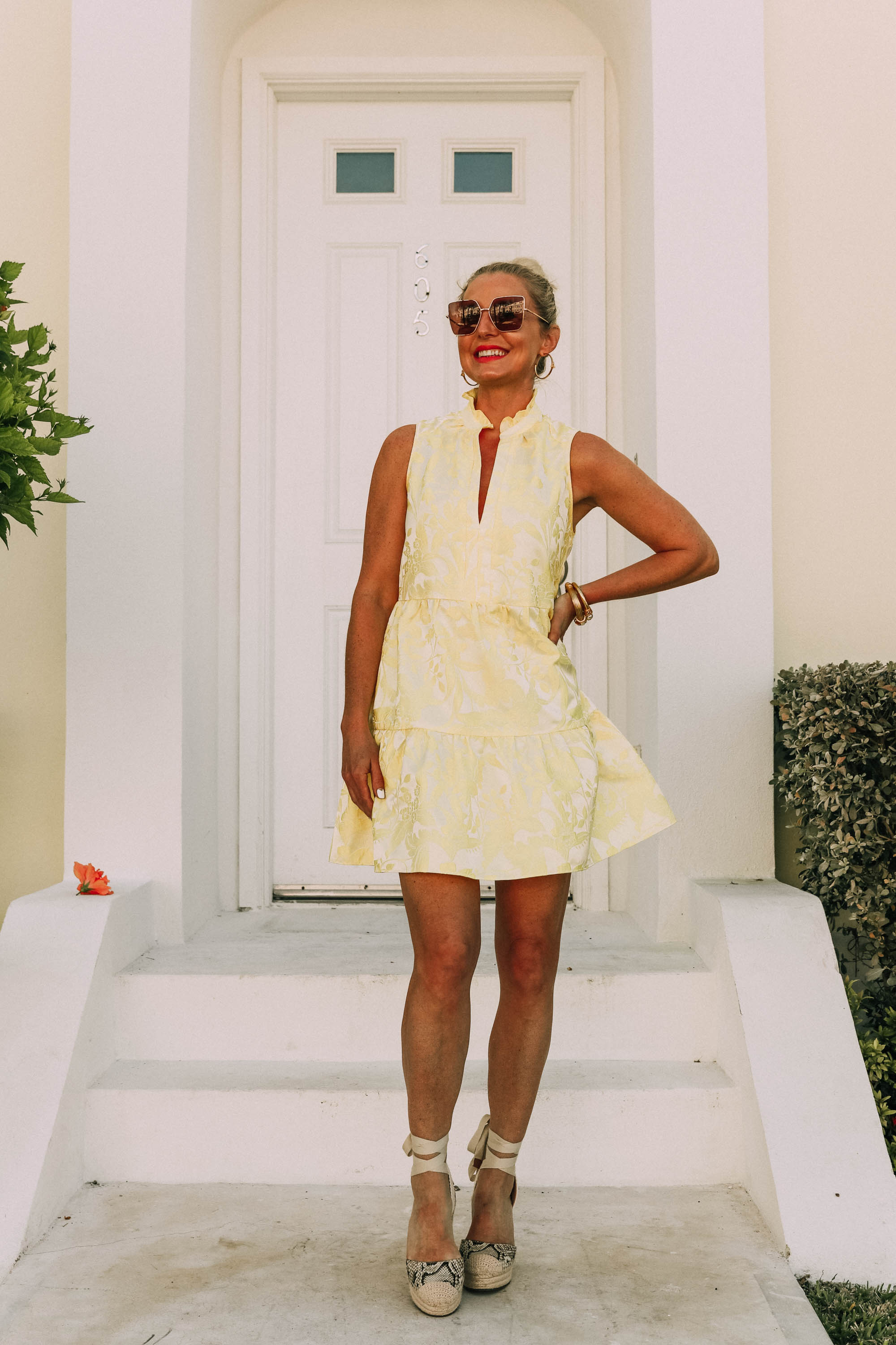 Pastels For Summer, Fashion blogger Erin Busbee of BusbeeStyle.com wearing a yellow dress by Amanda Uprichard with Vince Camuto espadrille wedges in the Bahamas