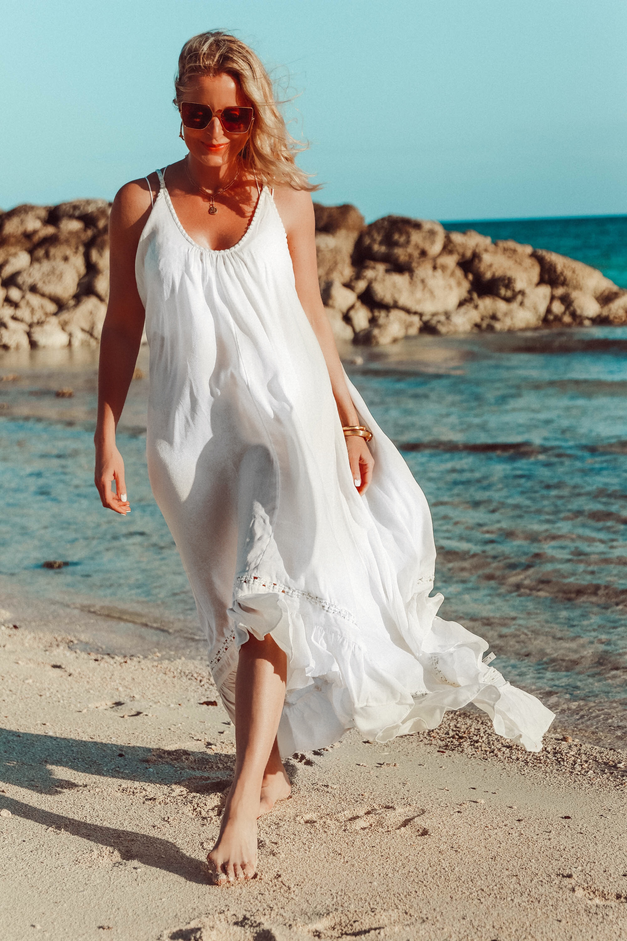 white Free People maxi swimsuit bathing suit coverup outfit on the beach