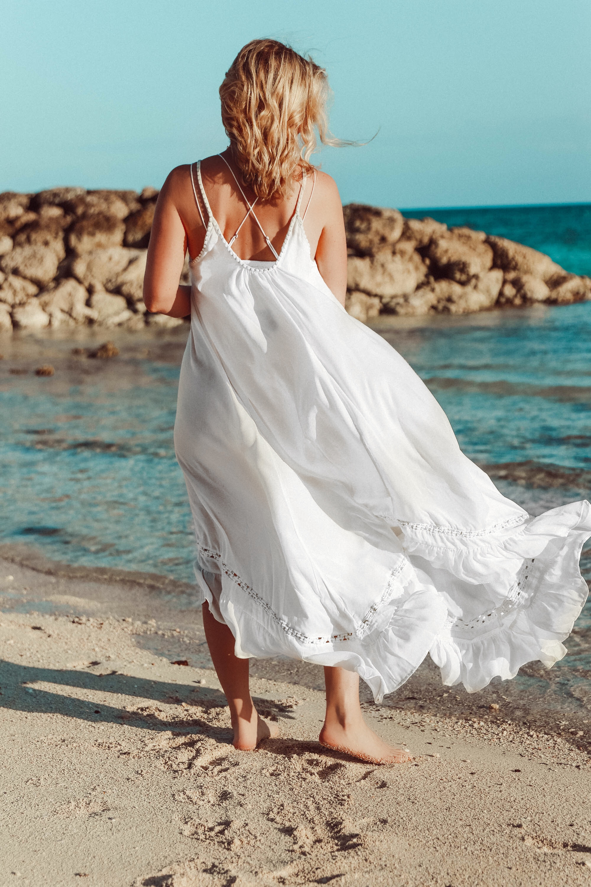 white Free People maxi swimsuit coverup outfit on the beach