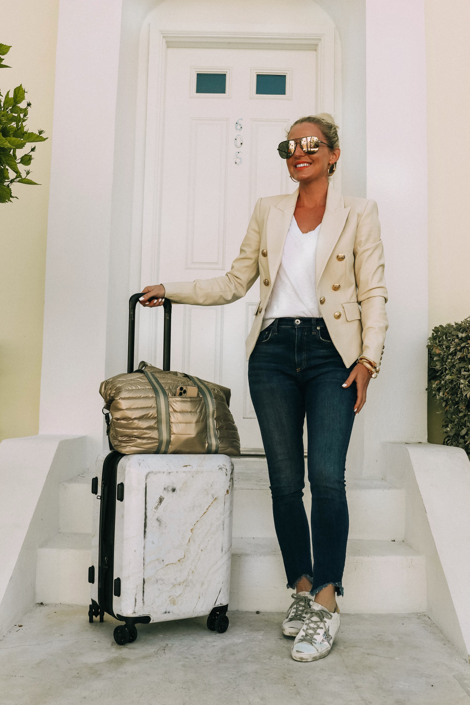 Golden Goose sneakers review Fashion blogger wearing white silver sequin Golden Goose superstar sneakers travel outfit with white marble Calpak suitcase