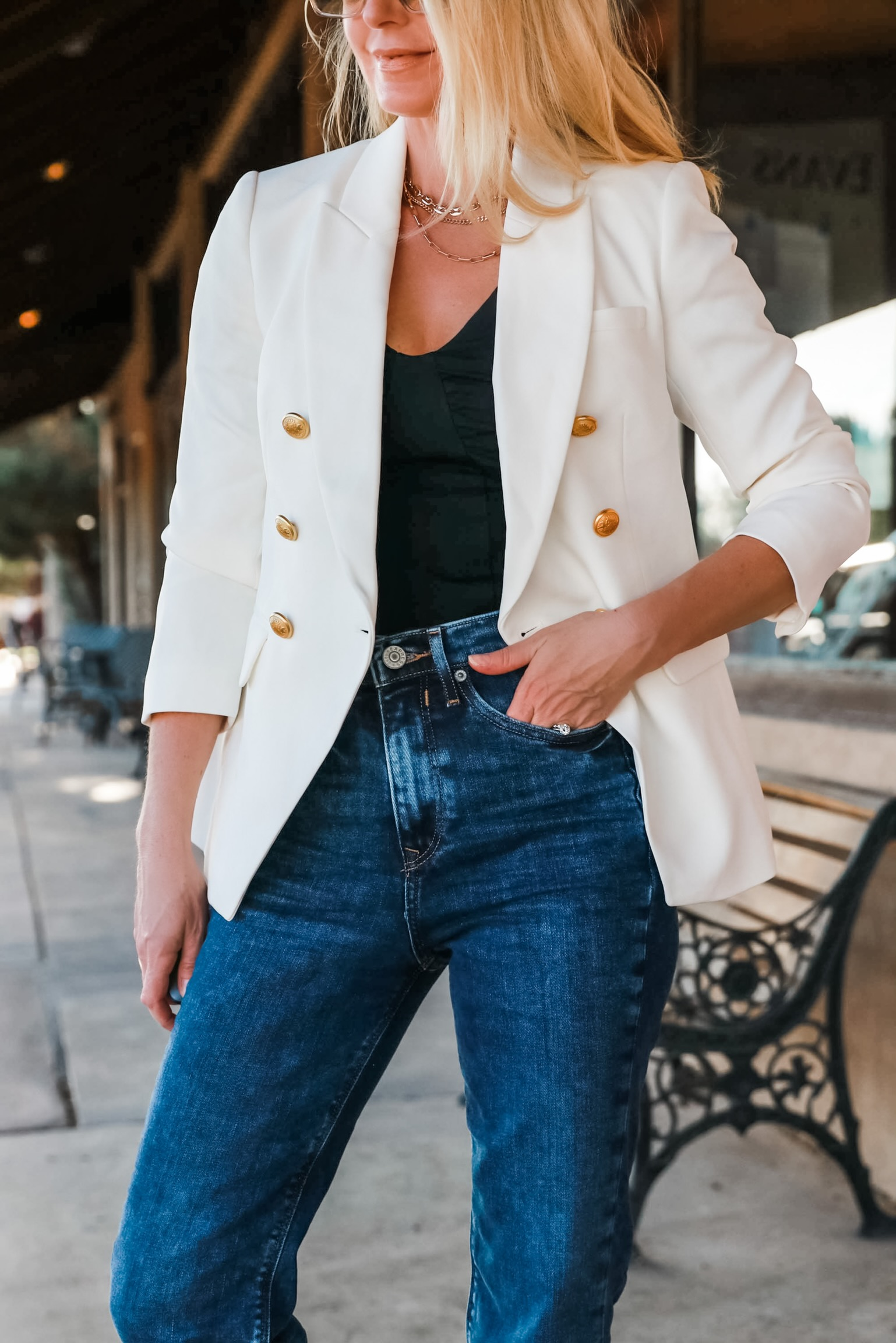 Affordable White Blazer, Fashion blogger Erin Busbee of Busbee Style wearing a white double breasted blazer, mom jeans, black puff shoulder bodysuit, and python sandals from Express in west Texas