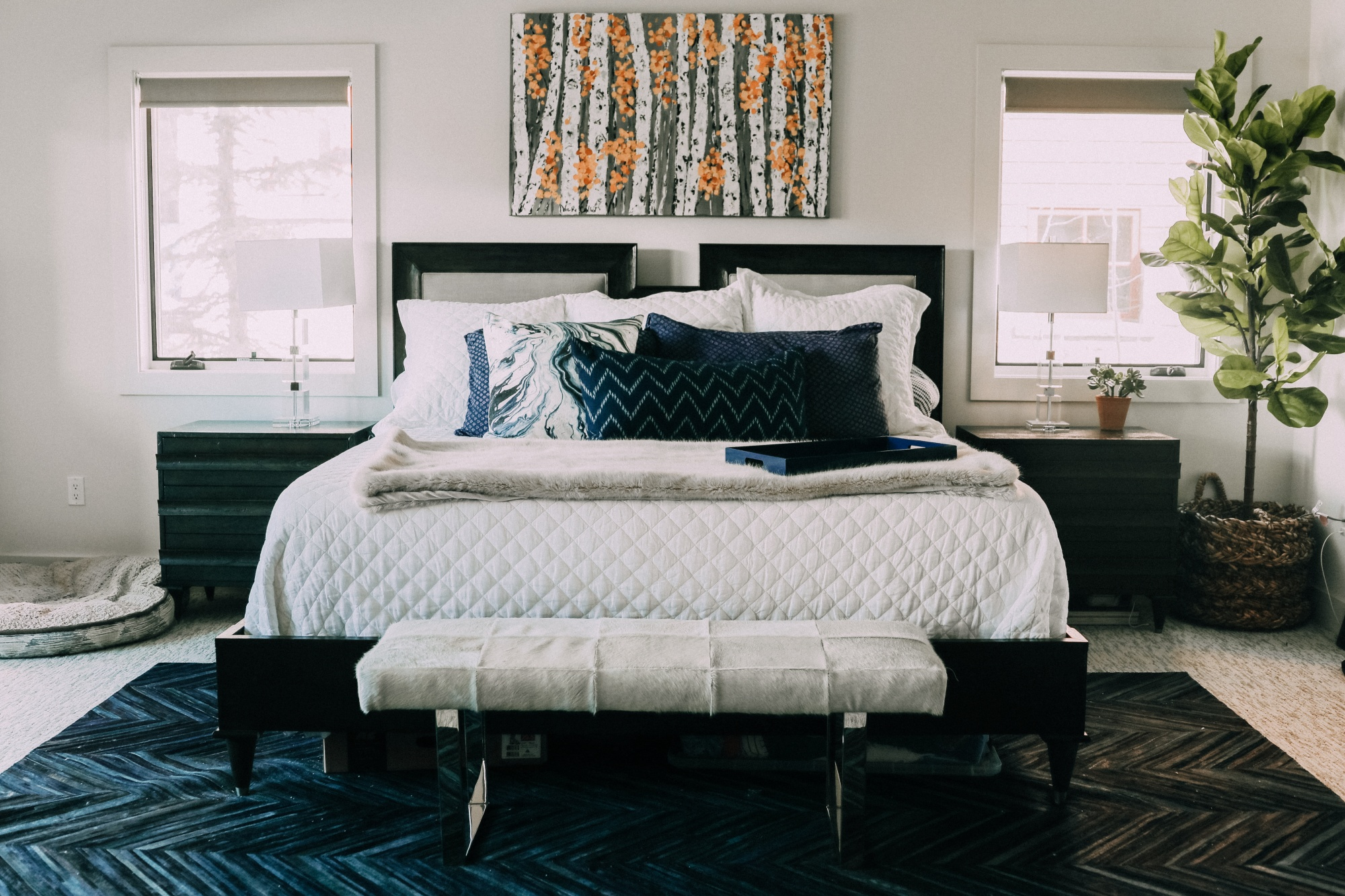 end of bed bedroom benches, white and silver One Kings Lane cowhide bench in master bedroom