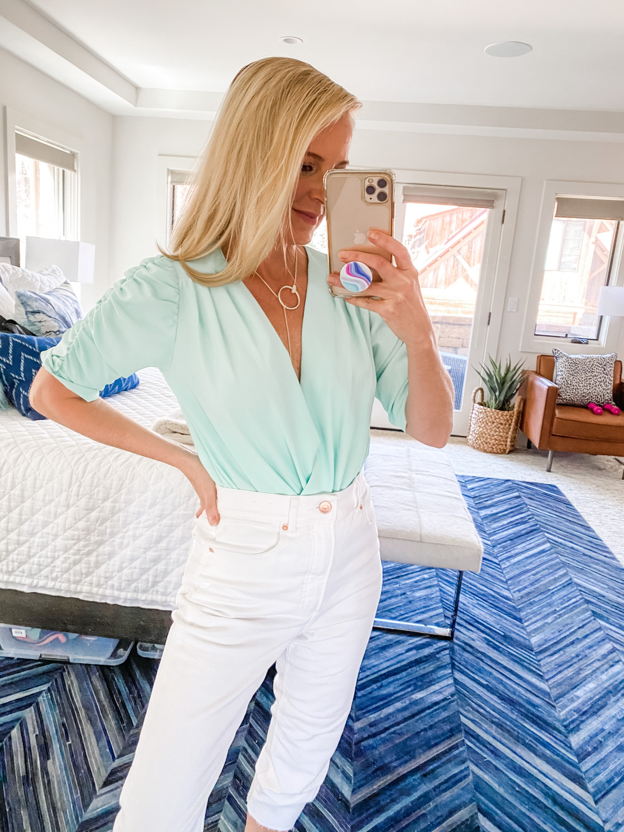 mint green wrap front Amanda Uprichard bodysuit spring outfit with white jeans on fashion blogger Busbee Style