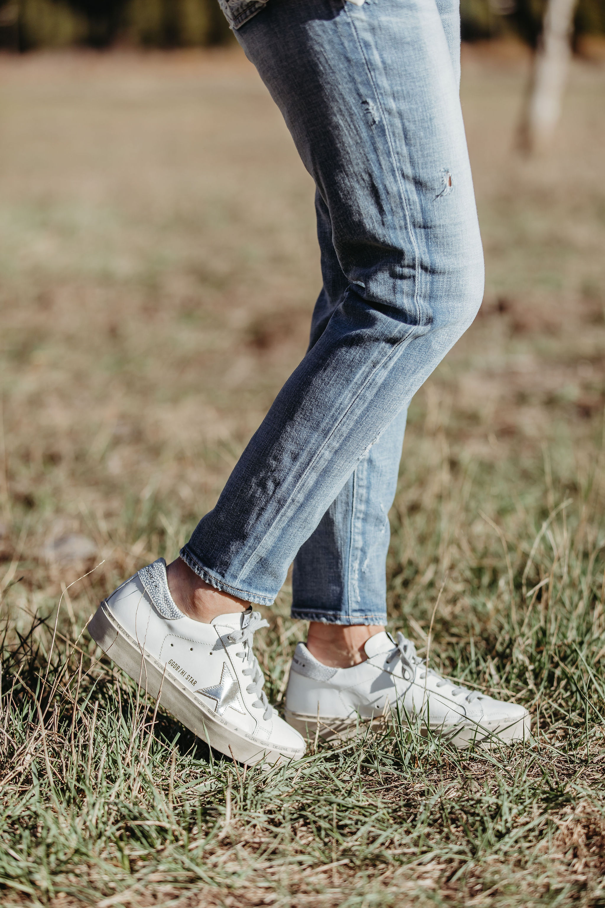 white Golden Goose platform sneakers all star with silver star blue jeans outfit