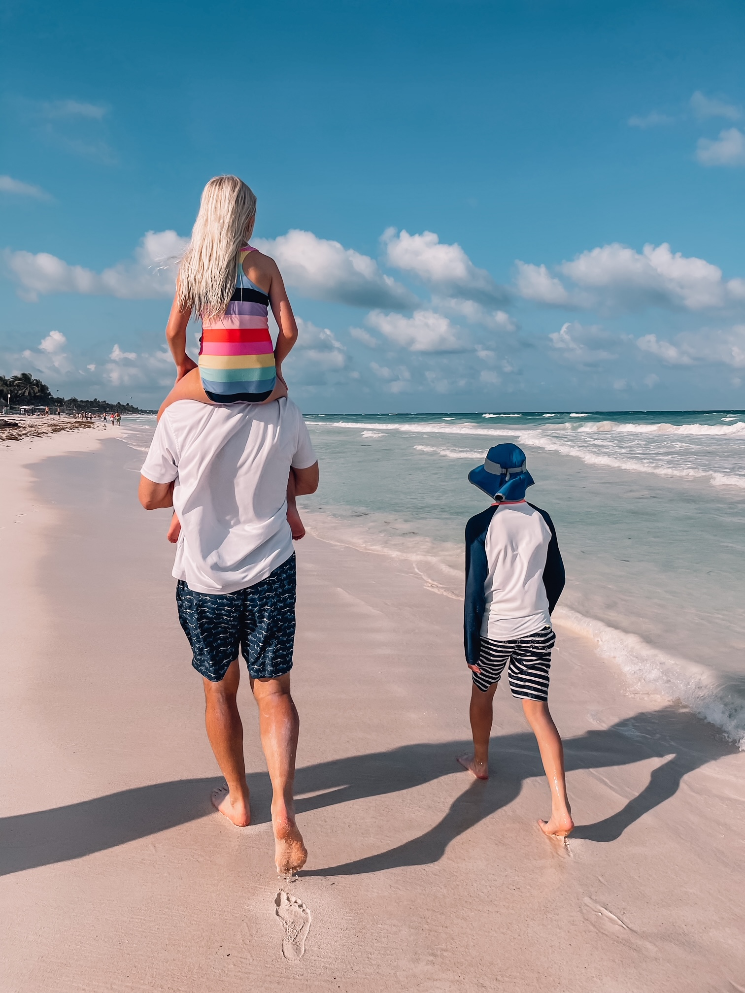 father's day gift ideas, fashion stylist over 40 Erin Busbee husband and children walking on the beach