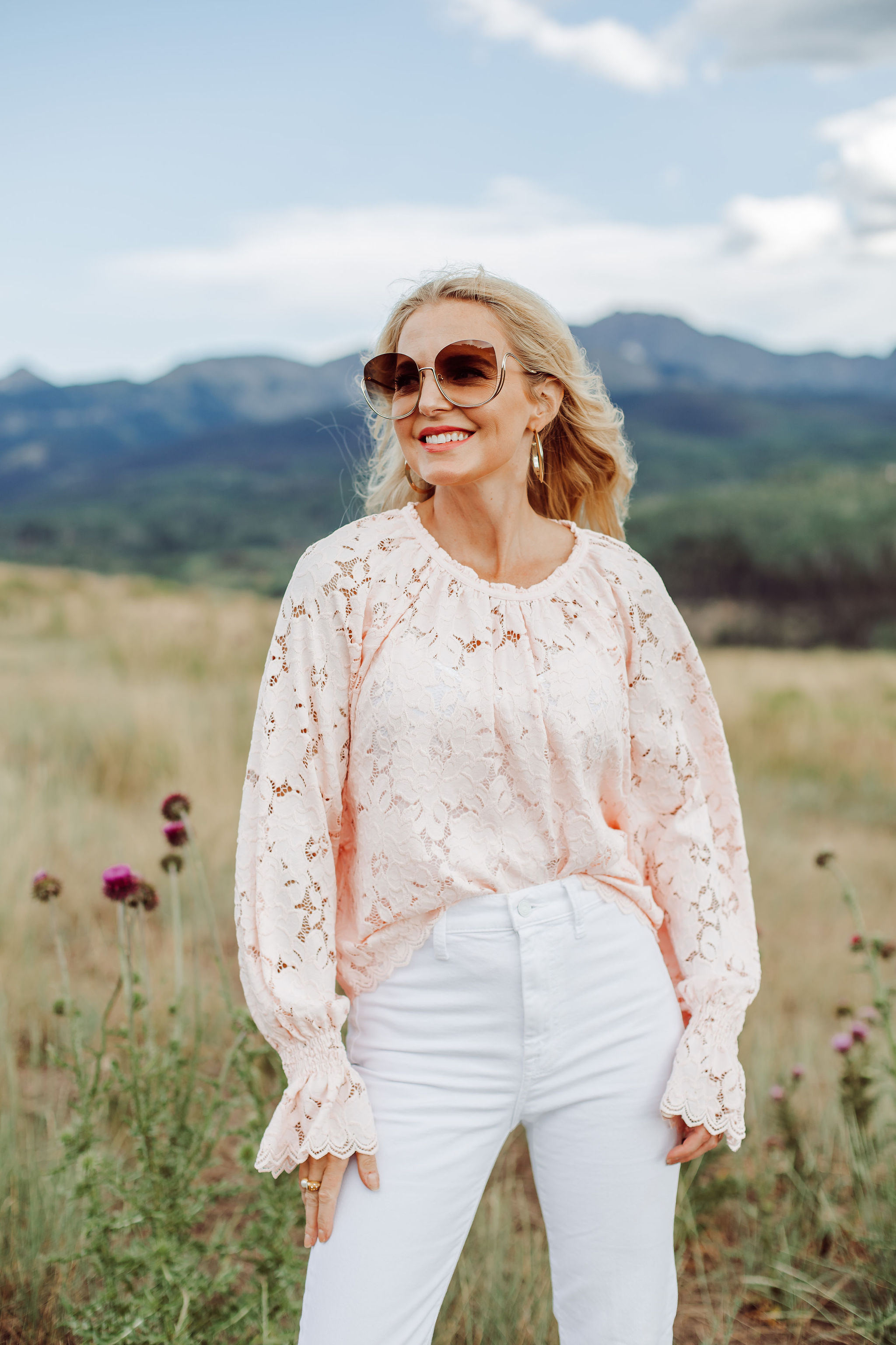 White Jeans Over 40, Fashion blogger Busbee Style wearing white 7 For All Mankind split hem jeans, pink lace long sleeve Free People top in Telluride, Colorado