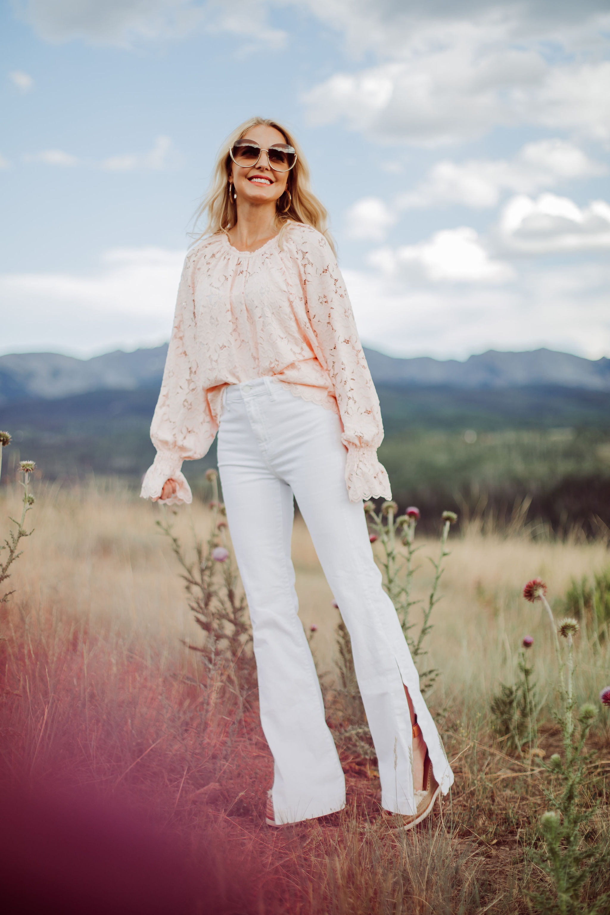 White Jeans Over 40, Fashion blogger Erin Busbee of Busbee Style wearing white 7 For All Mankind split hem jeans with See by Chloe espadrille wedges and pink lace long sleeve Free People top in Telluride, Colorado