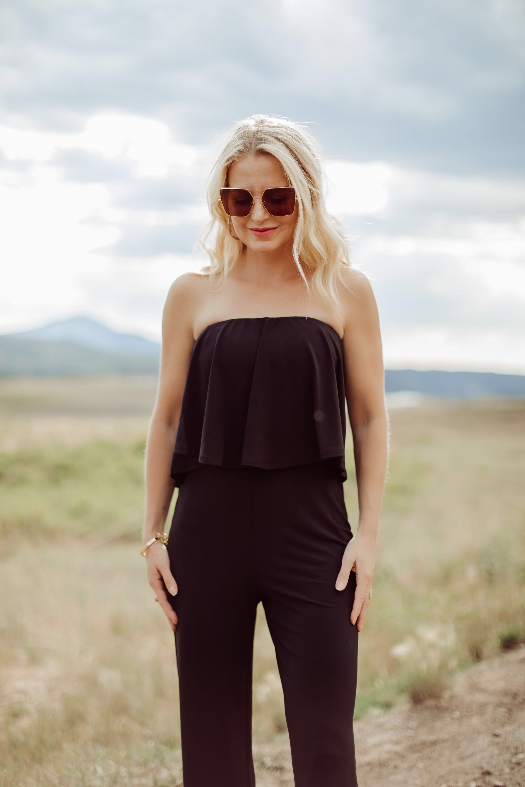 Jumpsuits Over 40, Fashion Blogger Erin Busbee of Busbee Style wearing a black flared jumpsuit by Scoop and black strappy block heel sandals by Scoop from Walmart in Telluride, Colorado