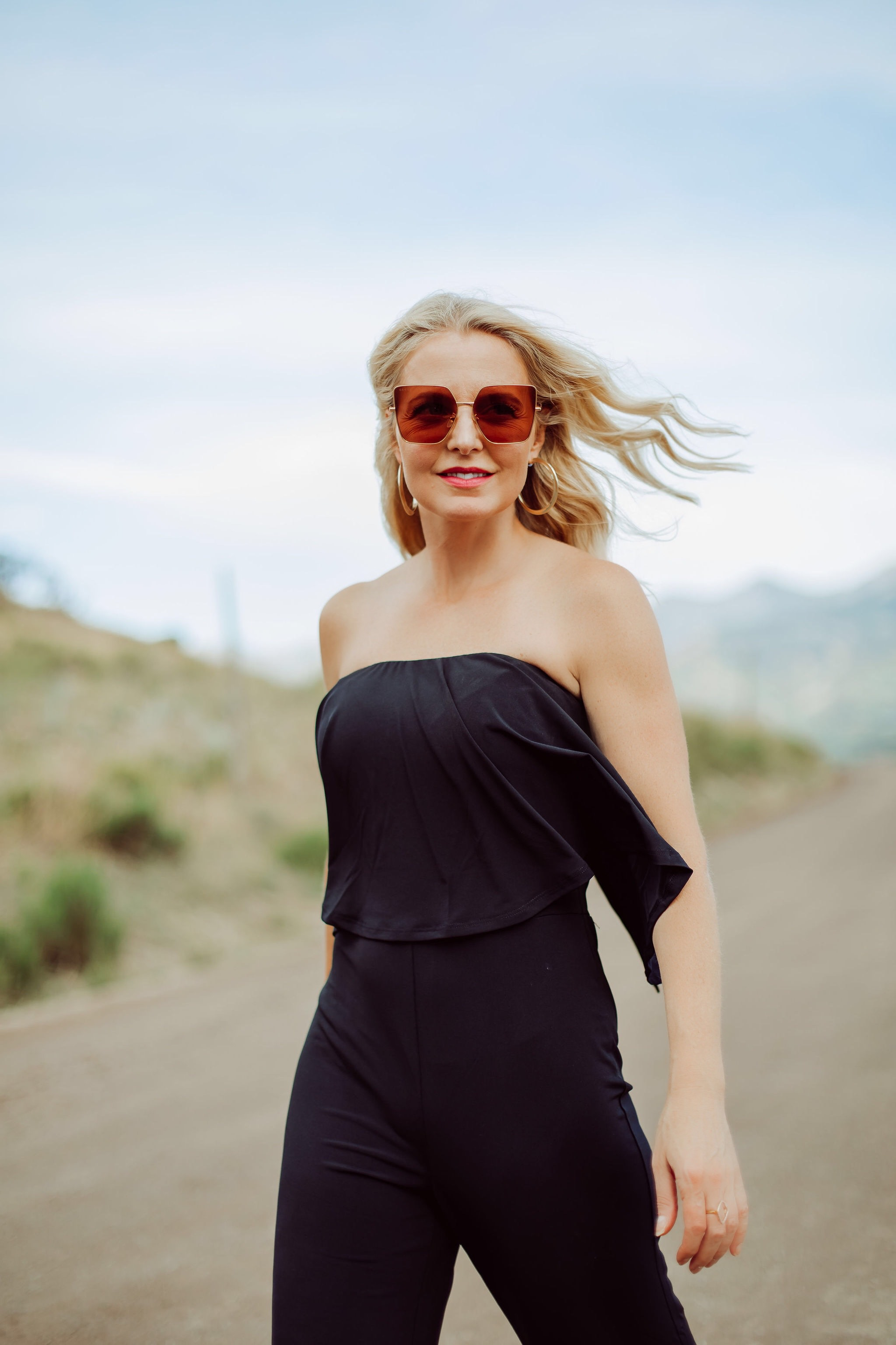 Jumpsuits Over 40, Fashion Blogger Erin Busbee of Busbee Style wearing a black flared jumpsuit by Scoop with flounce top and black strappy block heel sandals by Scoop from Walmart in Telluride, Colorado