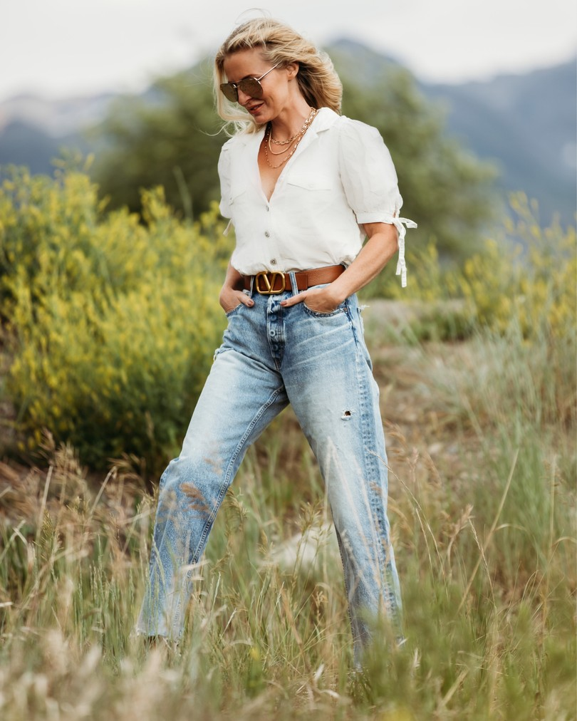 Summer Mom Style, Fashion blogger Erin Busbee of Busbee Style wearing a white safari top by Free People, Moussy Vintage Lomita wide straight leg jeans, and Bueno comfort sandals in Telluride, Colorado