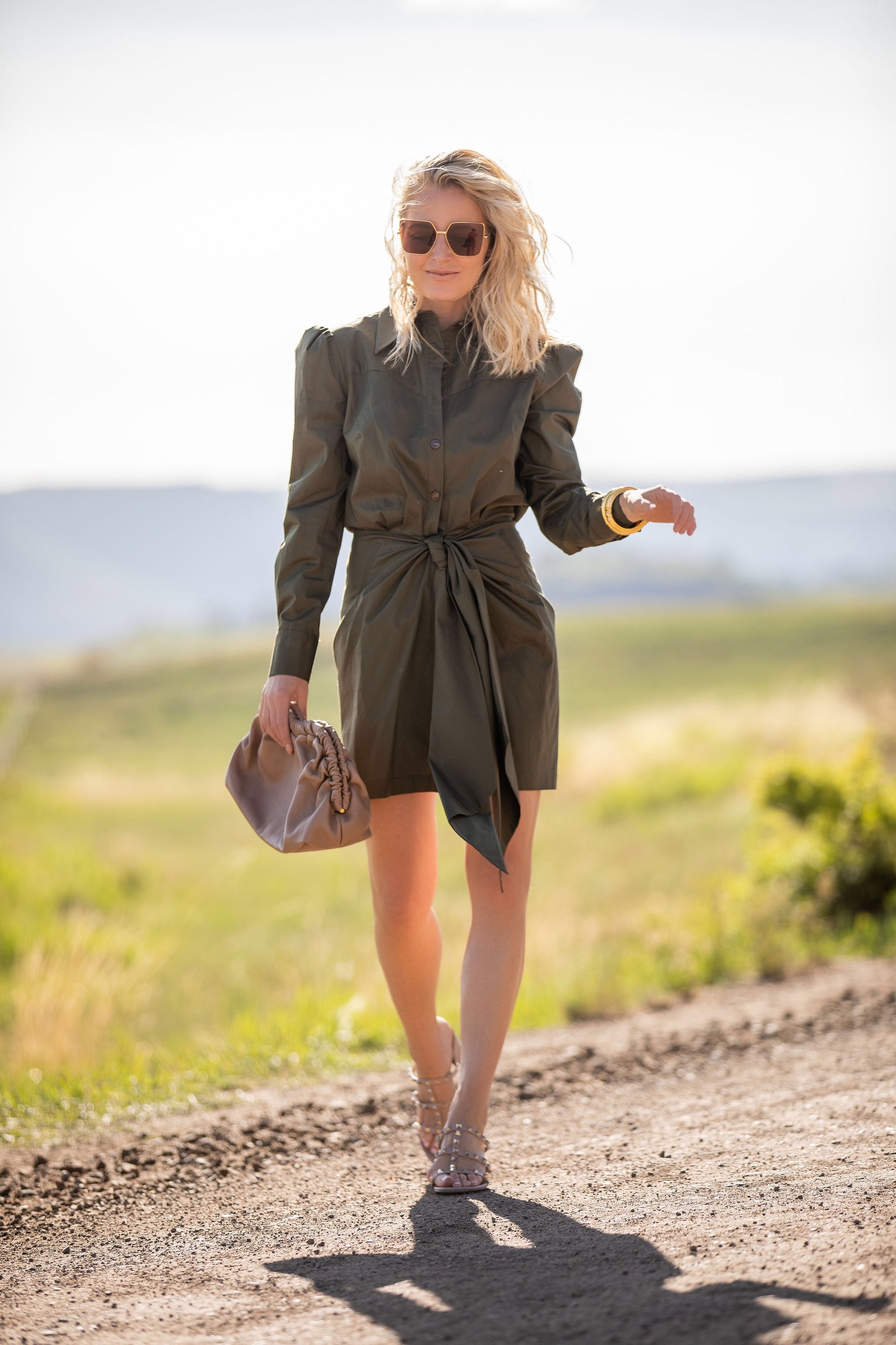Puff Sleeve Dress, Fashion blogger Erin Busbee of Busbee Style wearing a green puff sleeve tie front dress by Petersyn with Valentino sandals, Mansur Gavriel pouch bag, Julie Vos bracelets, and Aligheri necklaces in Telluride, Colorado