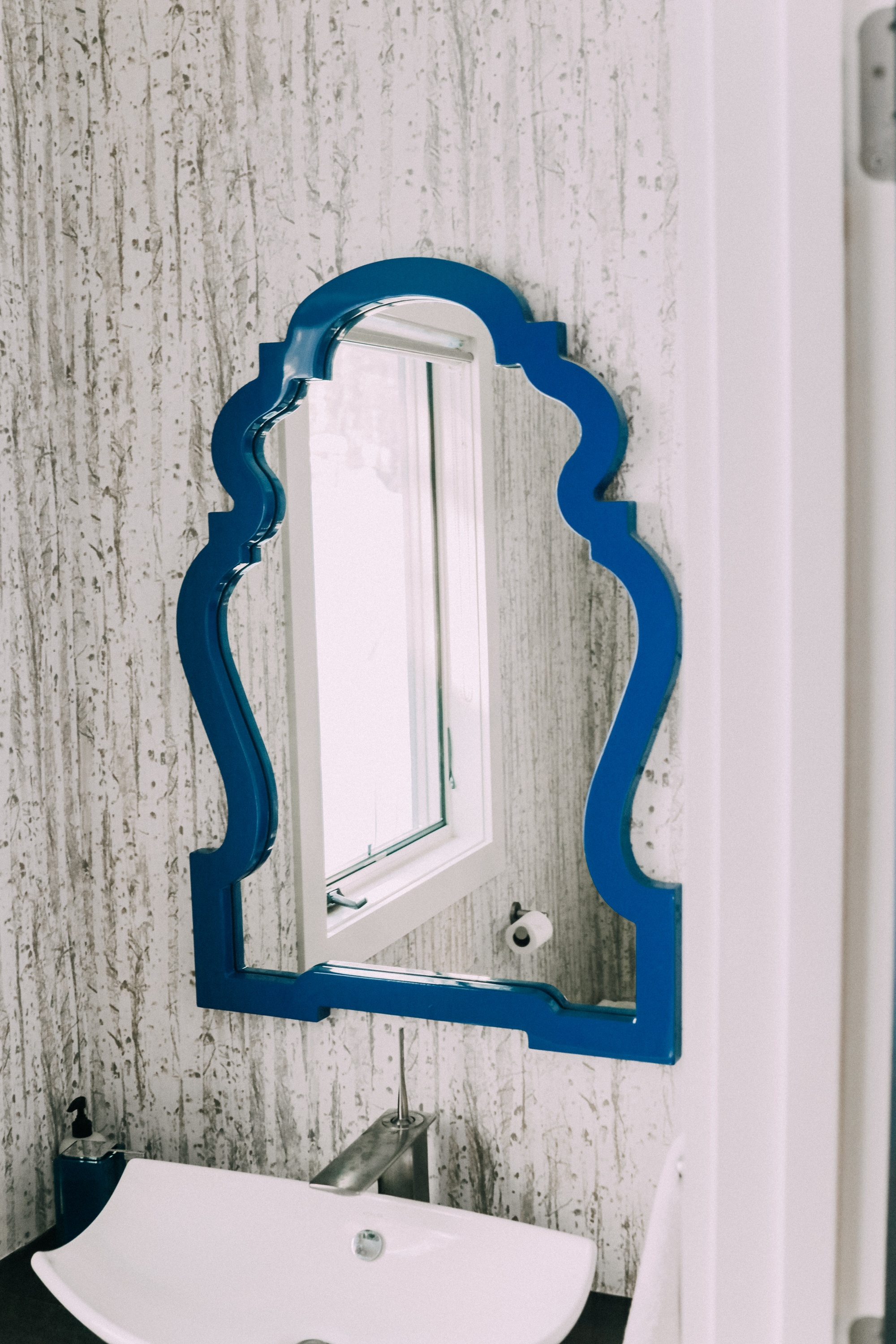 how to pick perfect wall mirror for home decor, blue arched vanity wall mirror in powder bathroom