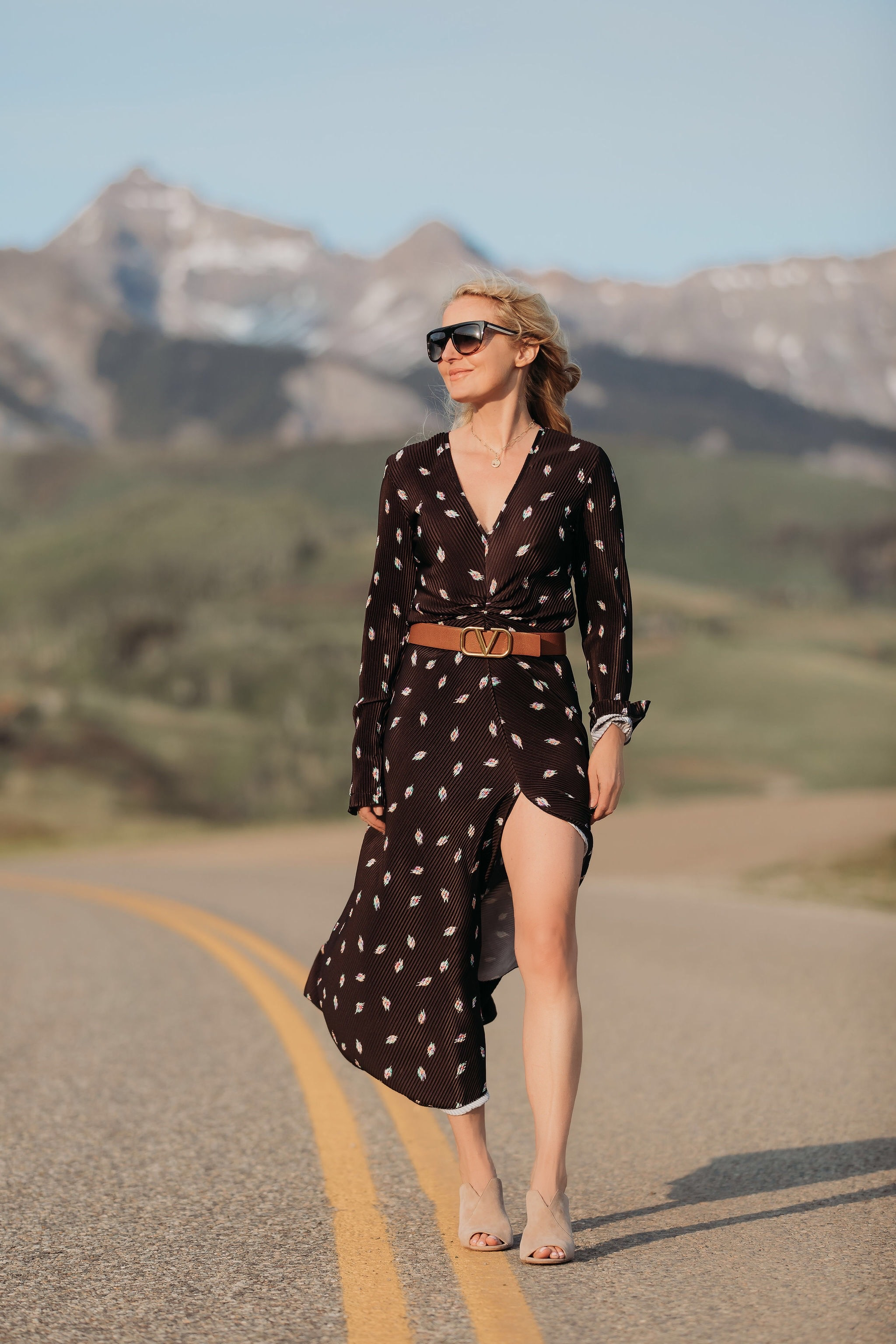 Black dress, fashion blogger Busbee Style wearing black printed Rotate dress with Valentino belt, nude Vince Camuto mules, and flat top sunglasses in Telluride, Colorado