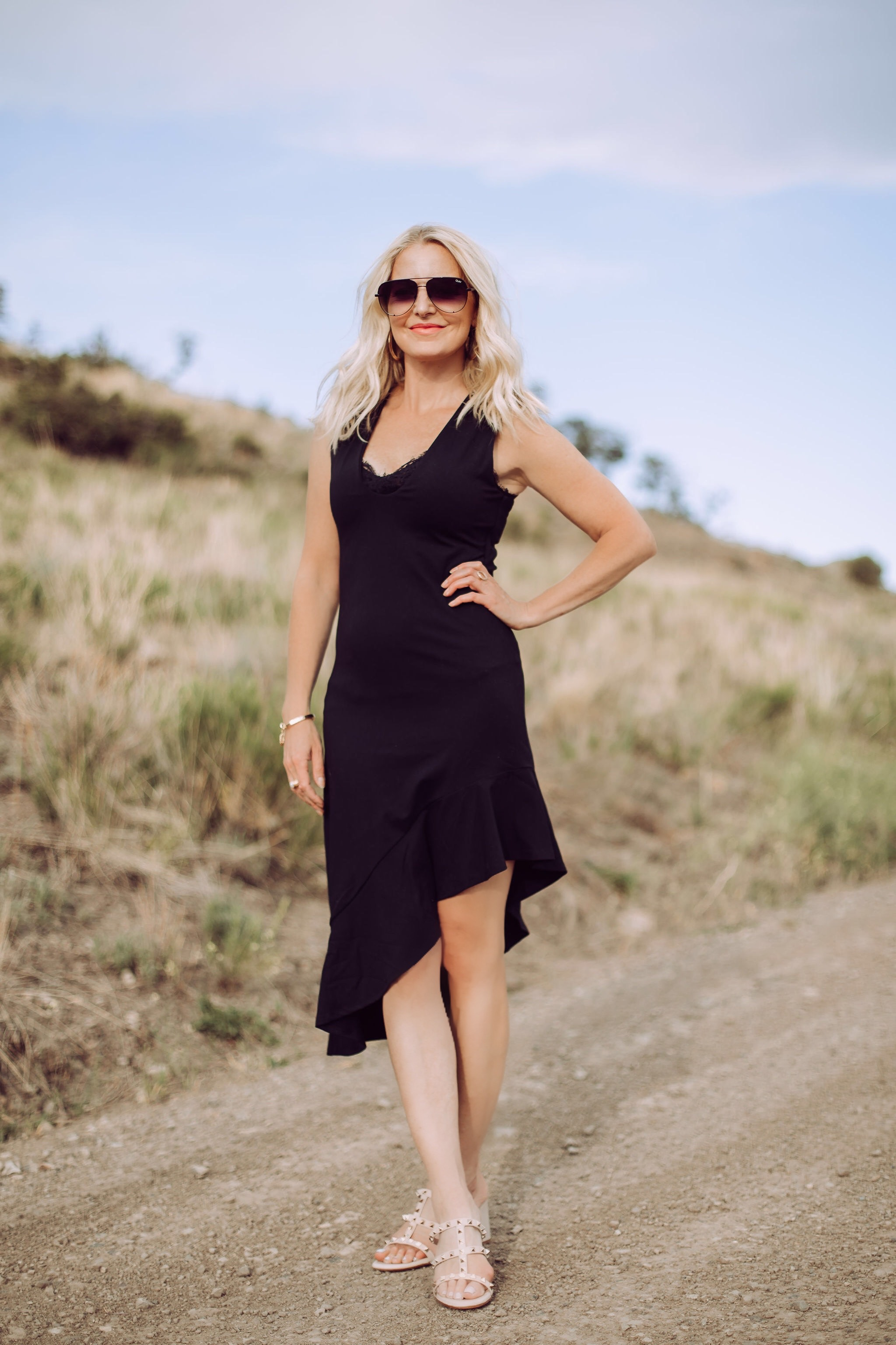 Date Night Outfit Over 40, Fahsion blogger Erin Busbee of Busbee Style wearing a black asymmetrical Susana Monaco dress with lace cami, Valentino Sandals, and QUAY aviator sunglasses in Telluride, Colorado