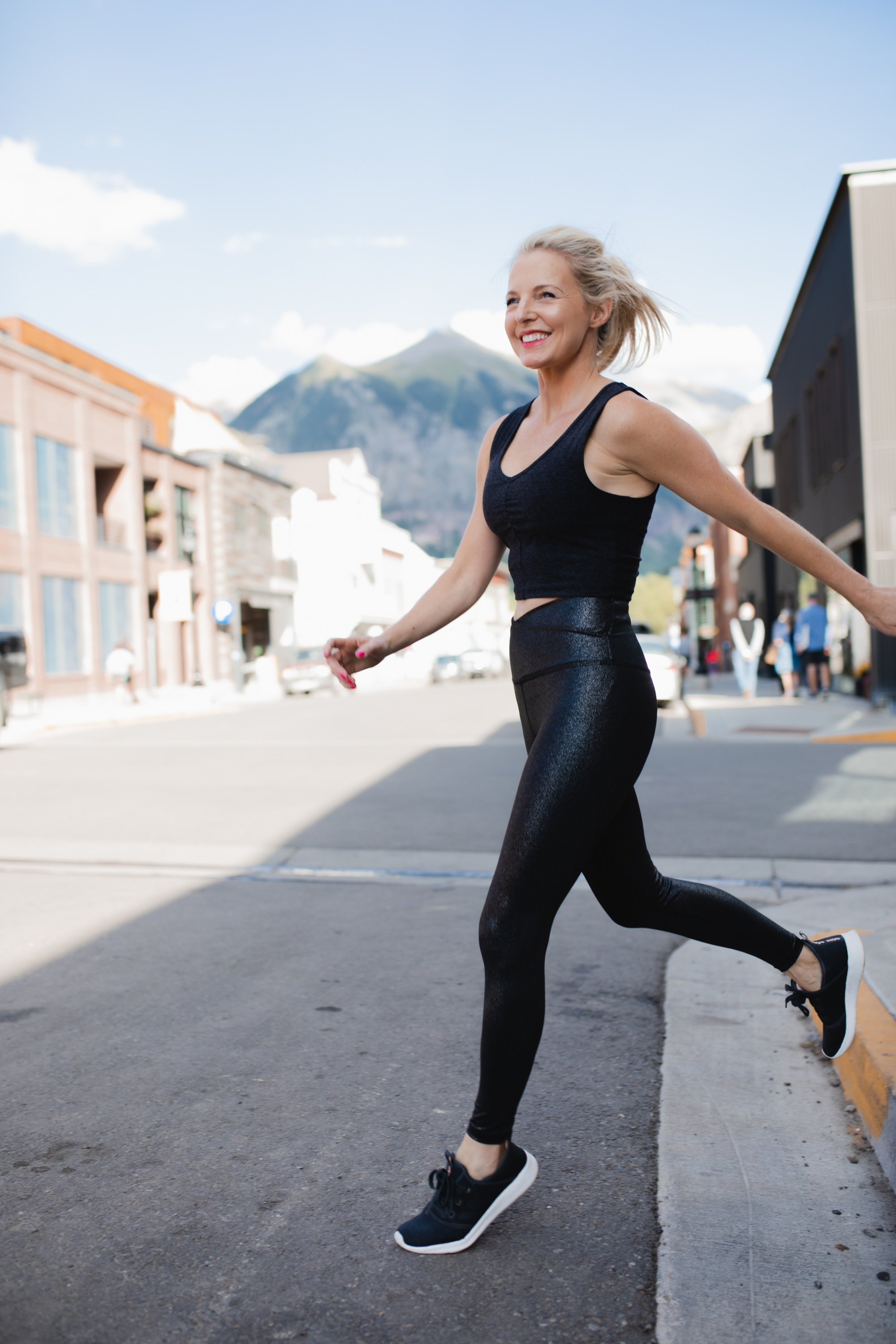 Nordstrom Sale Activewear, Fashion blogger Erin Busbee of Busbee Style wearing Beyond Yoga leggings, black Zella sports bra, and adidas sneakers from the Nordstrom Anniversary Sale in Telluride, Colorado, best activewear brands over 40