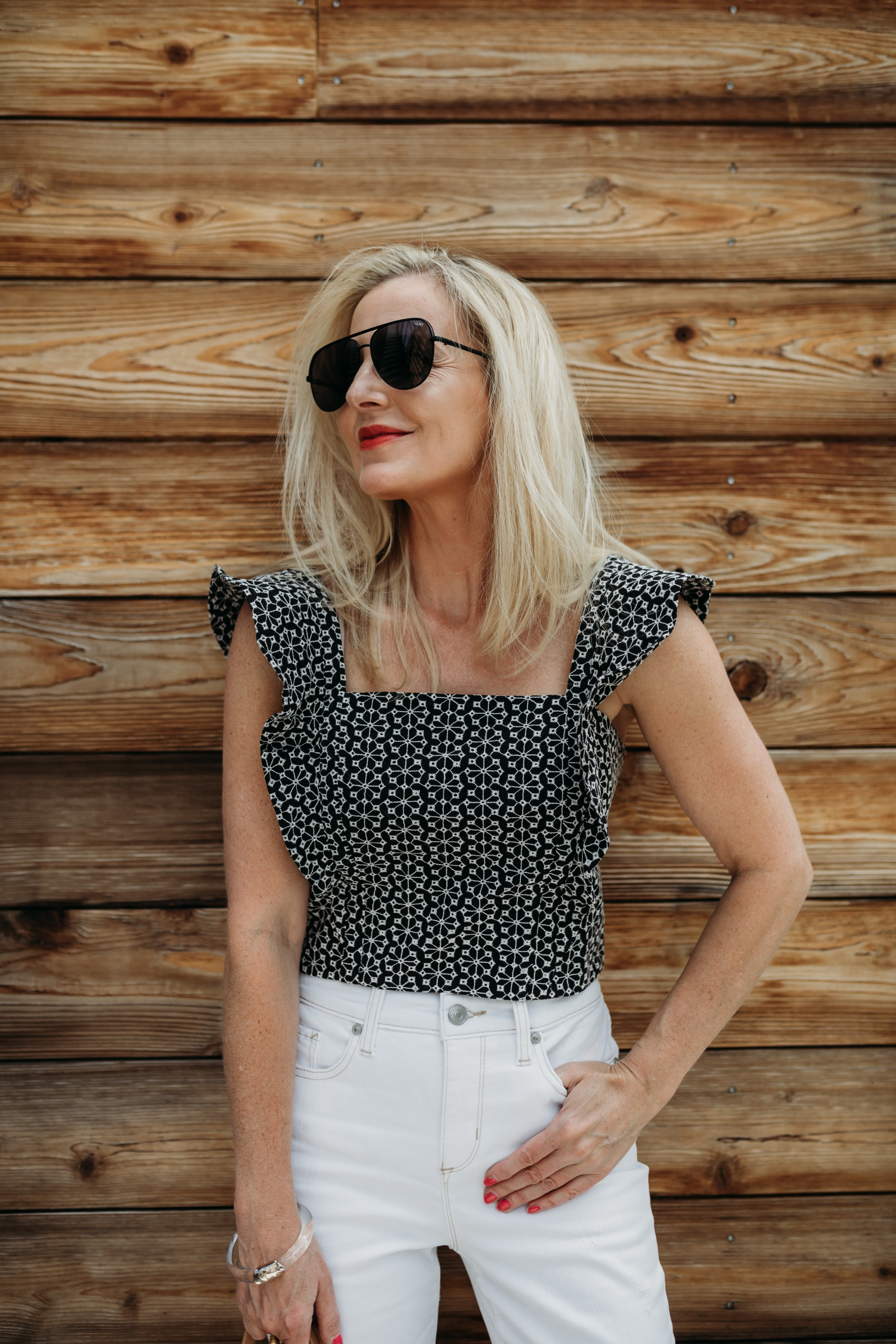 fashion blogger over 40 showing how to style a crop top over age 40 in age appropriate outfit