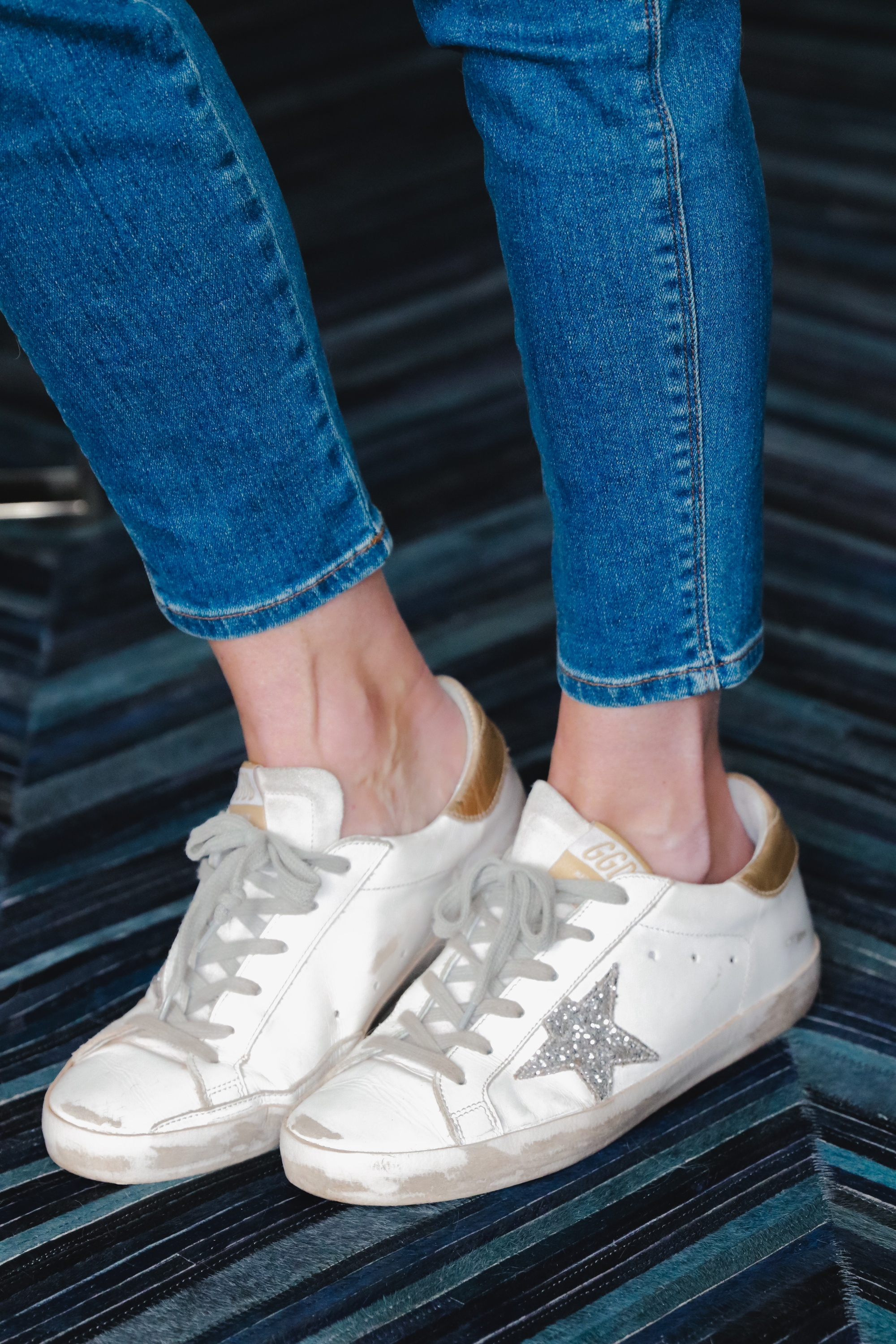white golden goose all star low top sneakers with J Brand Natasha skinny blue jeans