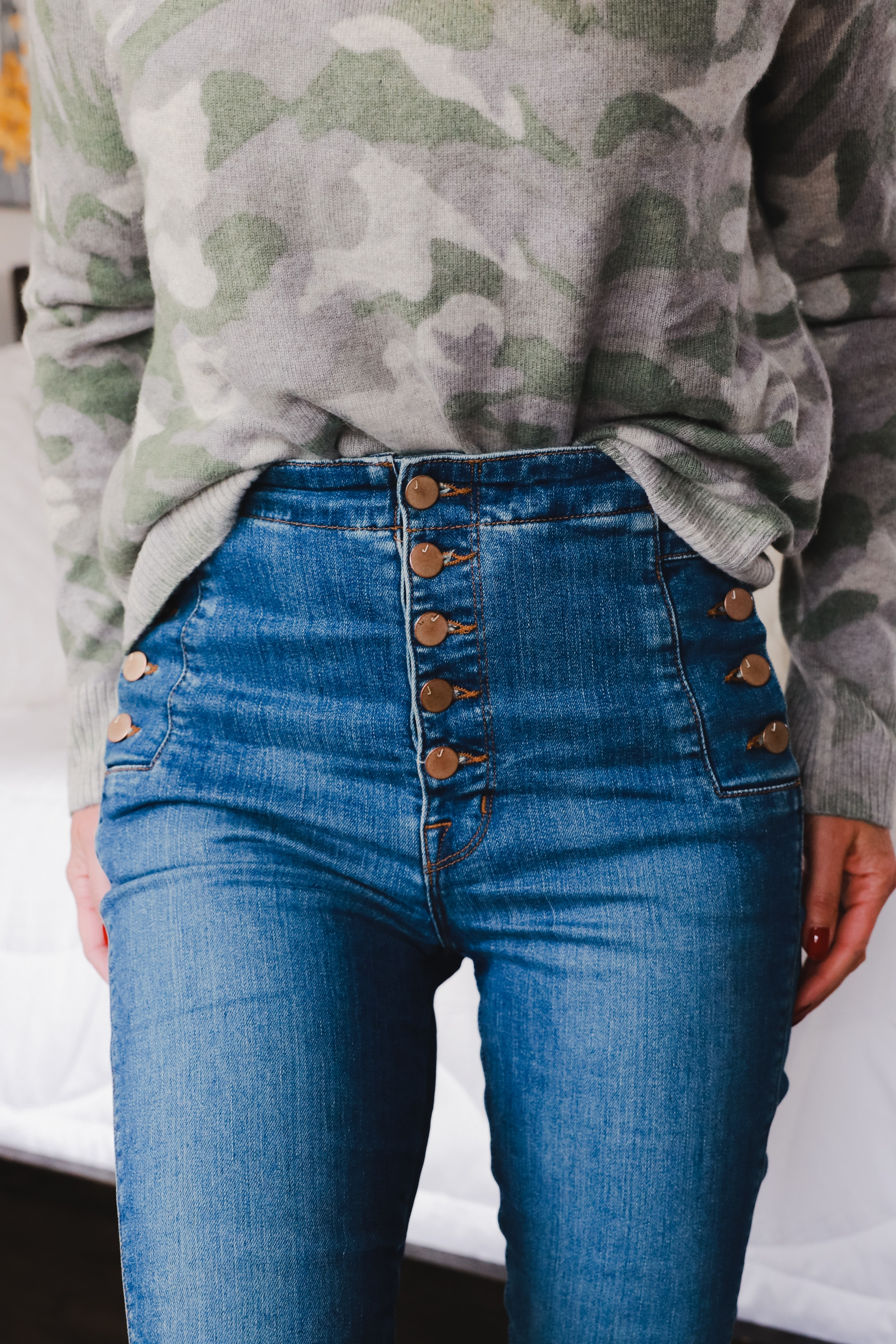 Aqua green camouflage women's crewneck long sleeve cashmere sweater with J Brand Natasha skinny button fly blue jeans