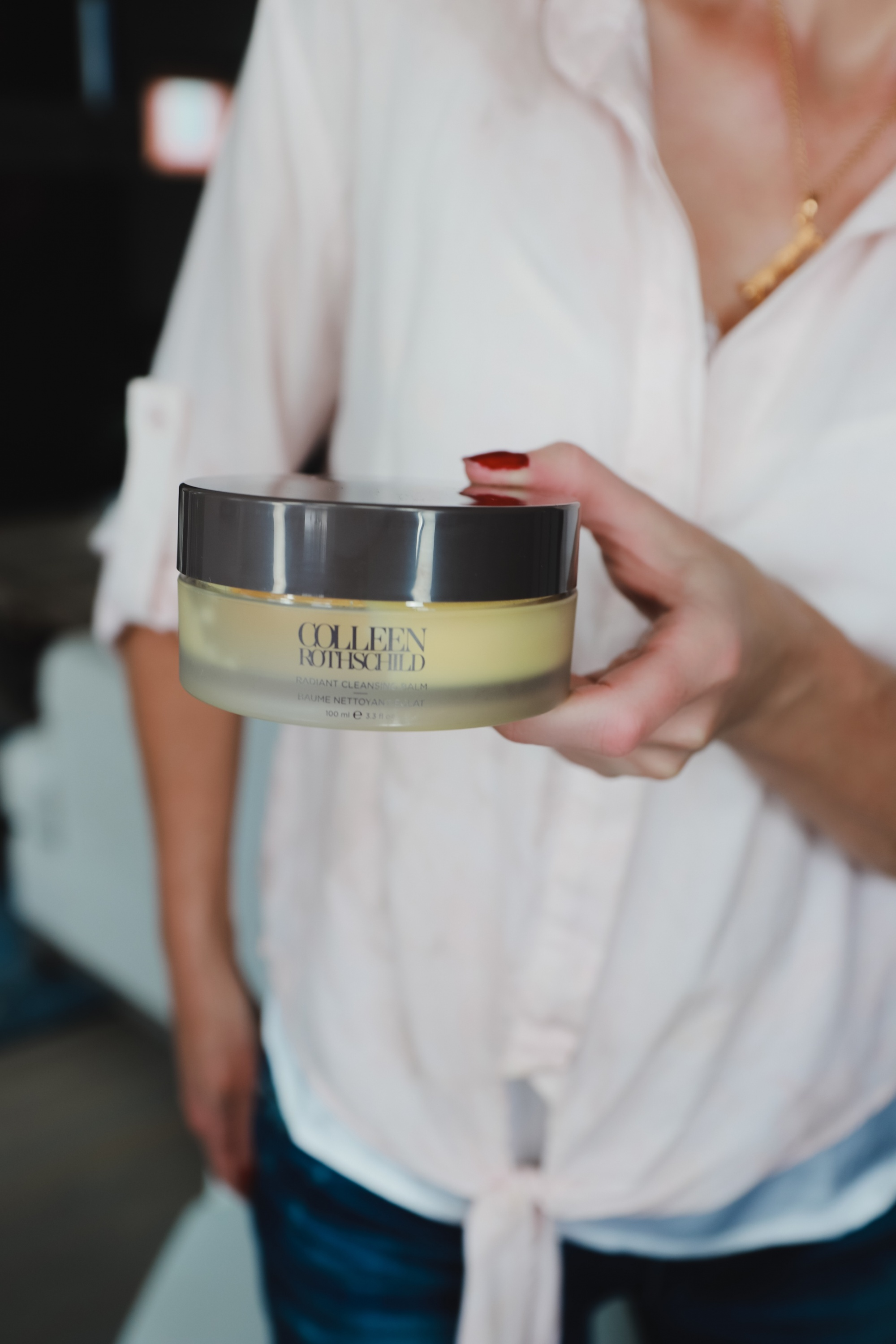 Favorite Skincare Brand, Erin Busbee of Busbee Style holding the Colleen Rothschild Radiant Cleansing Balm in her home in Telluride, Colorado