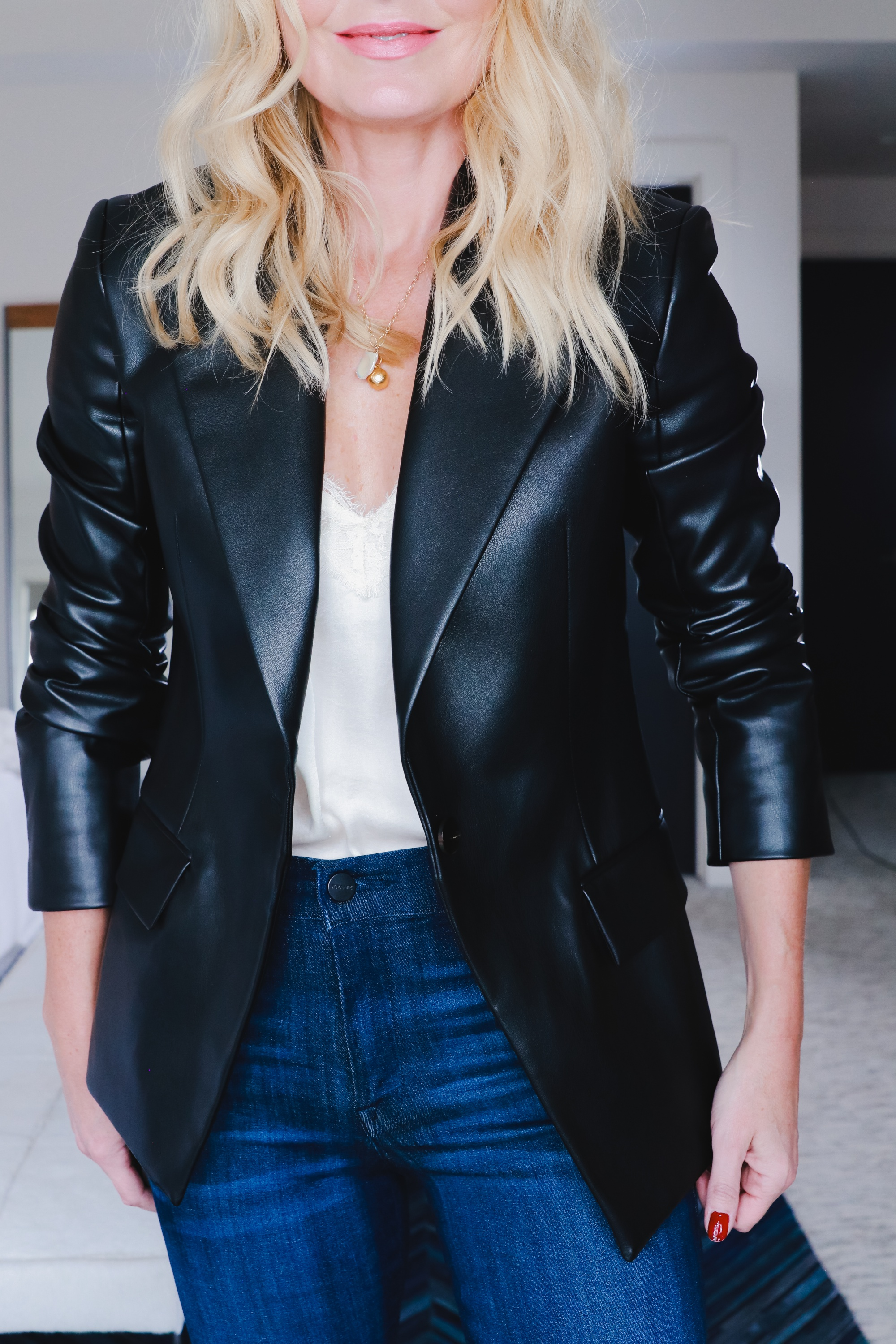 Boots With Jeans, Erin Busbee of Busbee Style sharing the complete guide to wearing jeans and booties wearing Frame skinny jeans, Louise et Cie black booties, a black Theory faux leather blazer, and white BP lace cami in her home in Telluride, Colorado