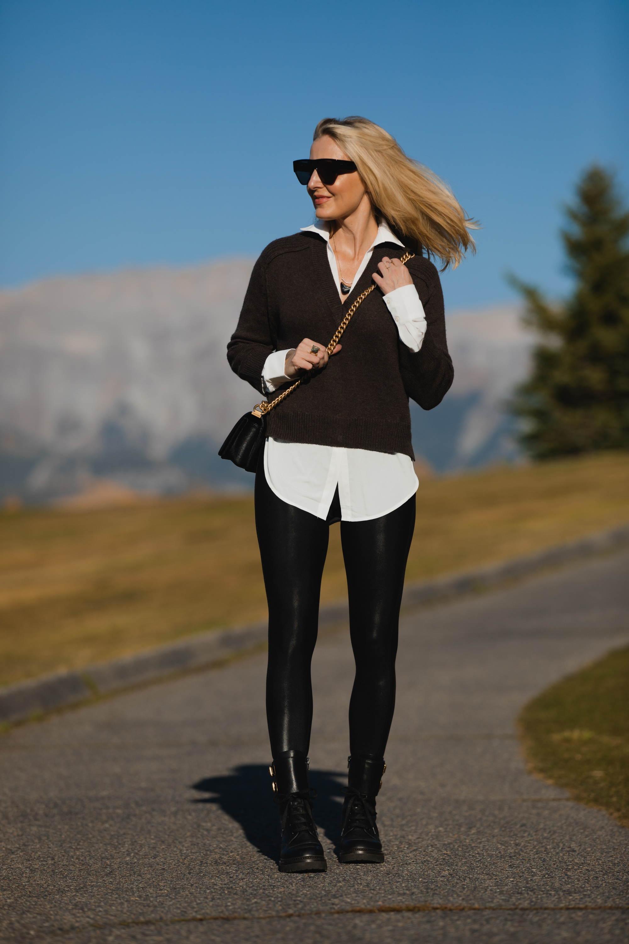 Layered Sweater, Erin Busbee of Busbee Style wearing a brown layered sweater by Brochu Walker, Spanx faux leather leggings, See by Chloe combat boots, and black Chanel boy bag in Telluride, Colorado