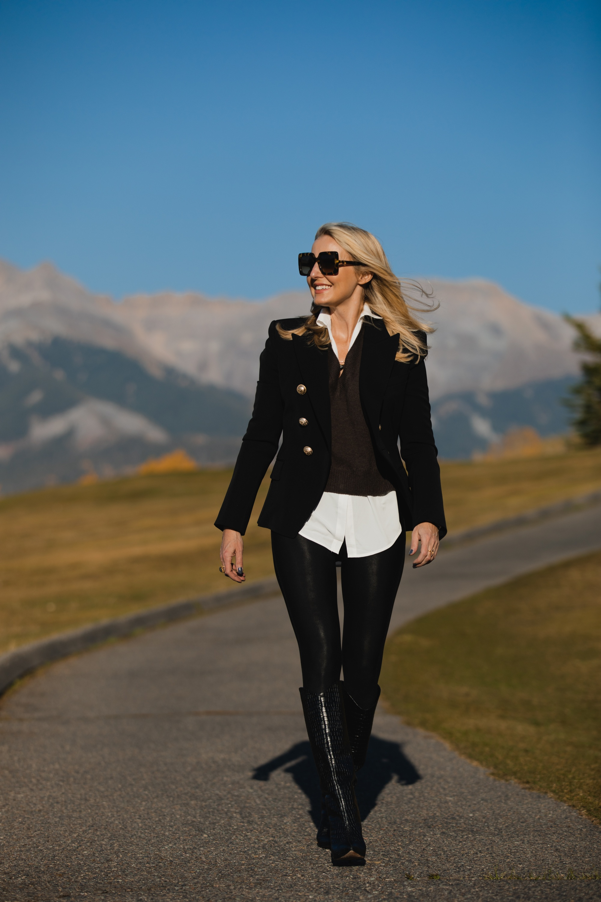 Layered Sweater, Erin Busbee of Busbee Style wearing a brown layered sweater by Brochu Walker, Spanx faux leather leggings, black croc embossed boots by Schutz, and black Balmain blazer in Telluride, Colorado