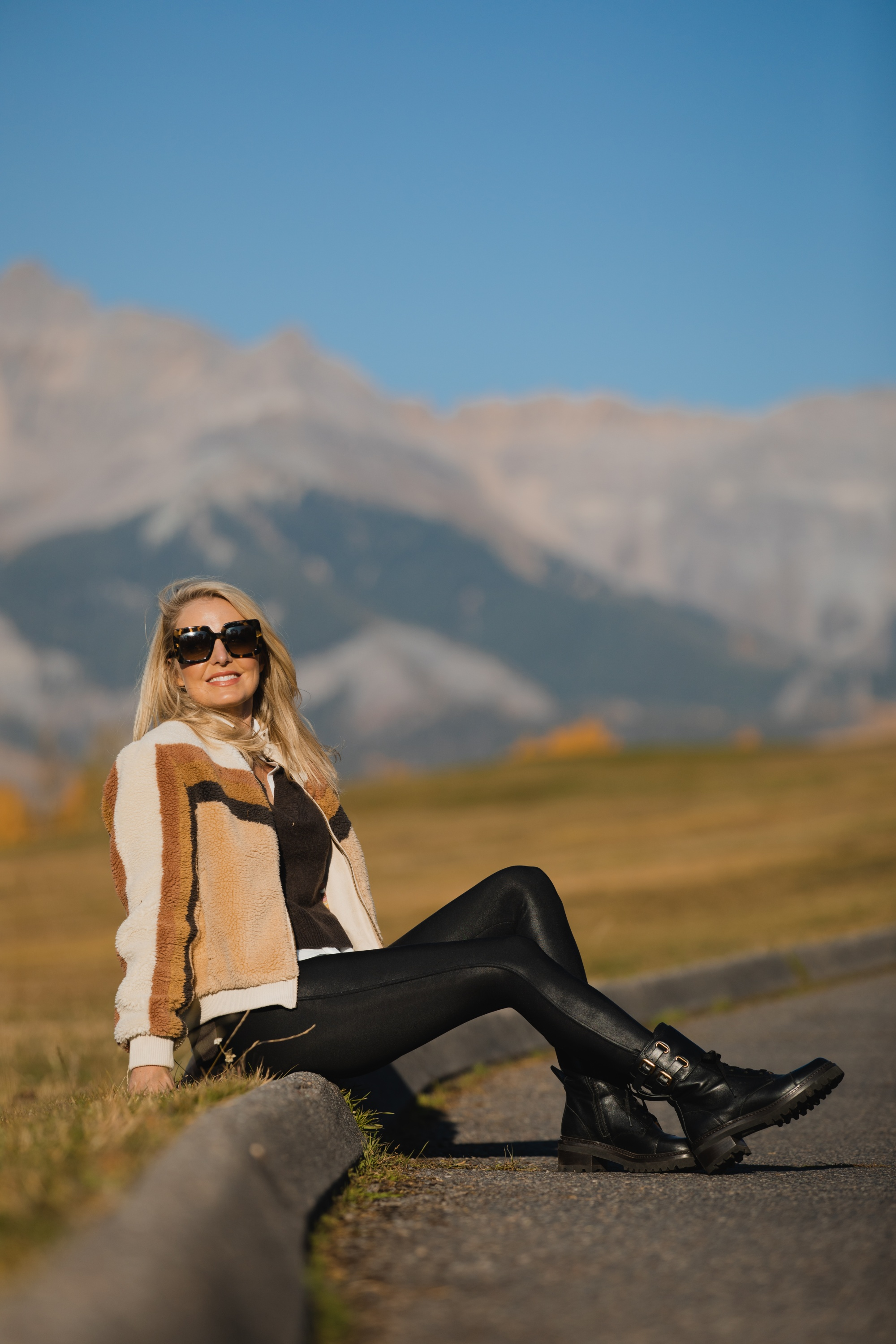Fall Jackets, Erin Busbee of Busbee Style wearing a striped sherpa jacket by Mother over a brown Brochu Walker layered sweater with Spanx faux leather leggings and See by Chloe combat boots in Telluride, Colorado