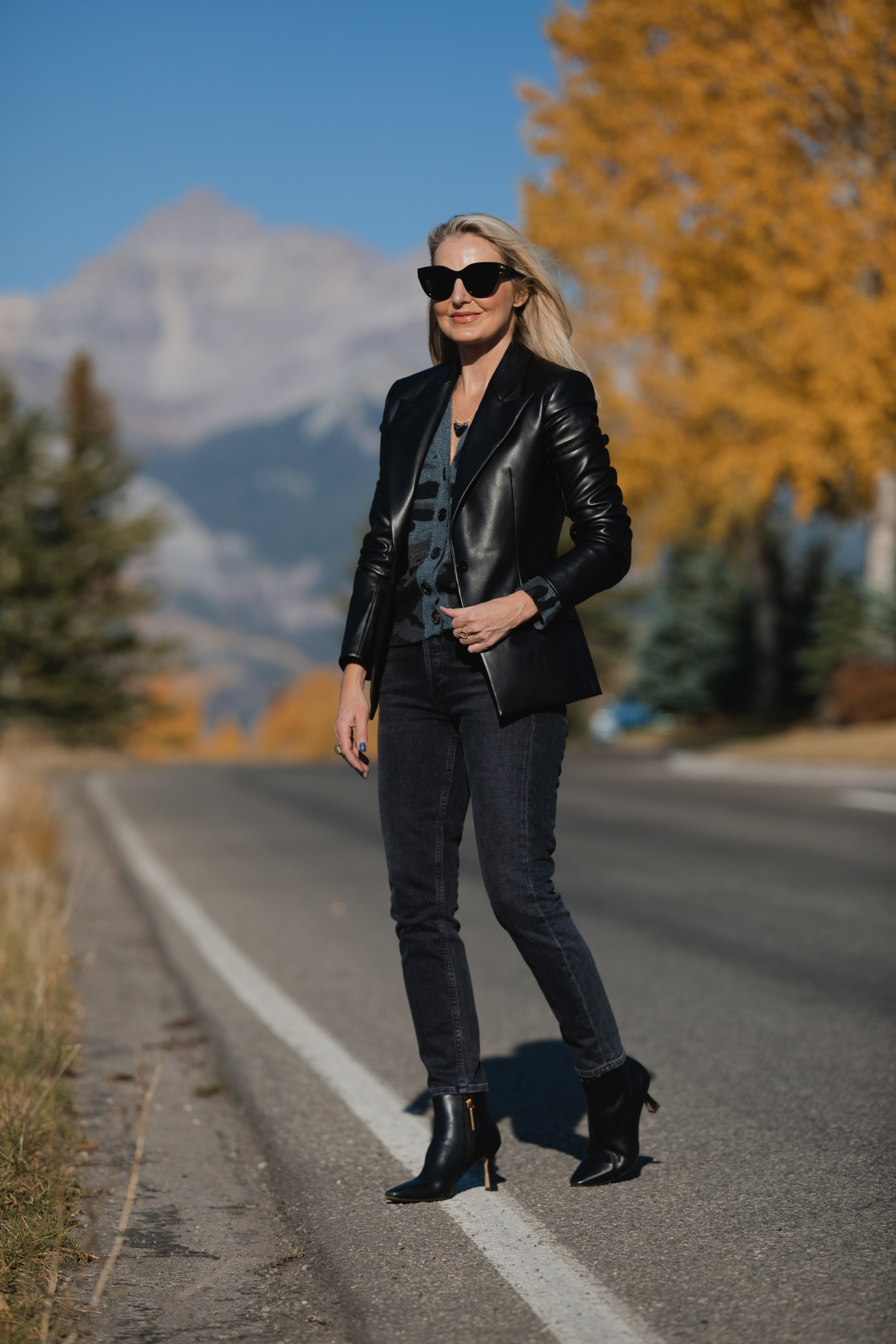 Favorite Fall Jackets, Erin Busbee of Busbee Style wearing a black faux leather blazer by Theory with dark gray wash Agolde Nico jeans, black Louise et Cie booties, and Rails camo cardigan sweater in Telluride, Colorado
