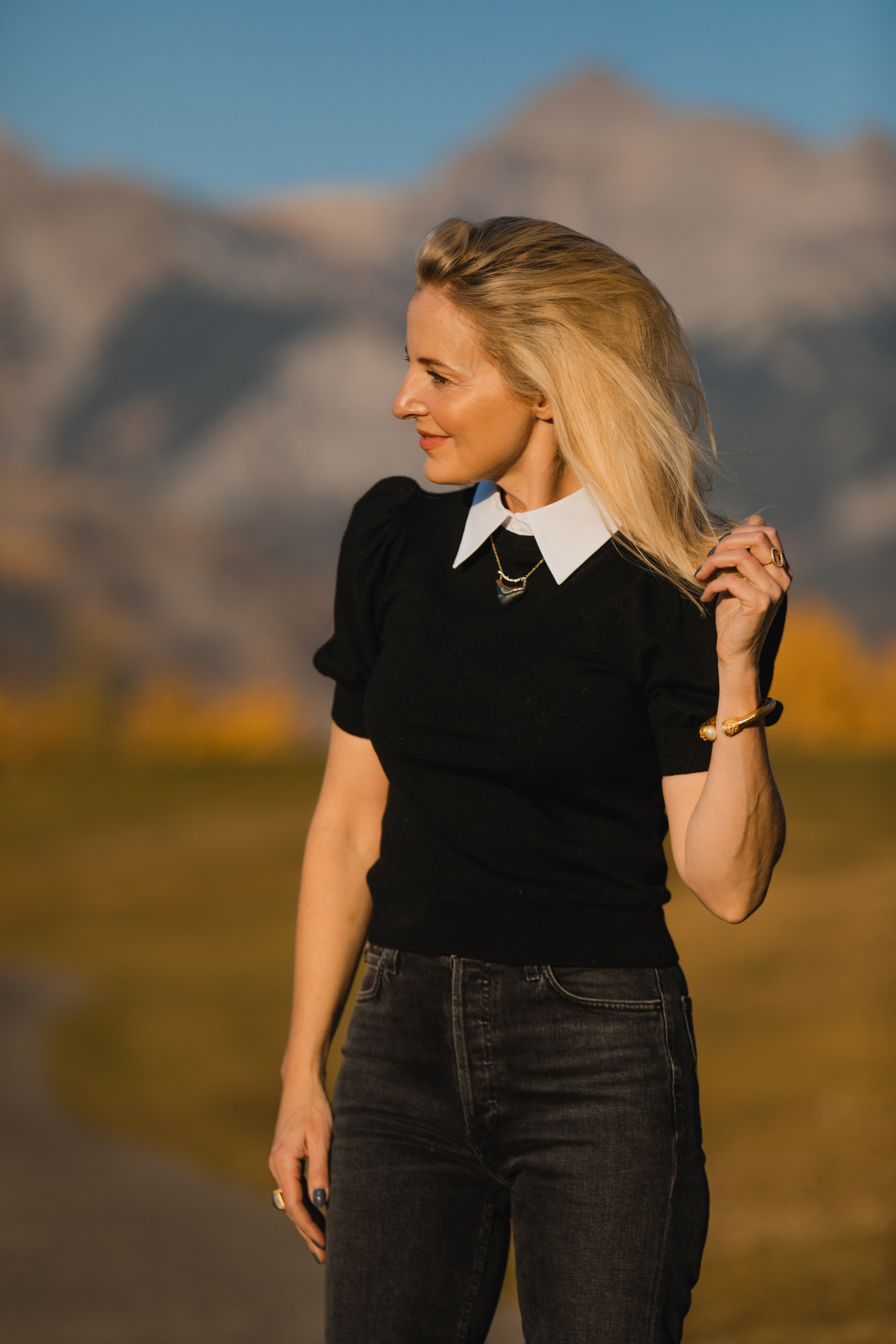 Layered Sweater, Erin Busbee of Busbee Style wearing a black puff shoulder layered sweater by Alice + Olivia with gray wash Agolde Nico jeans in Telluride, Colorado