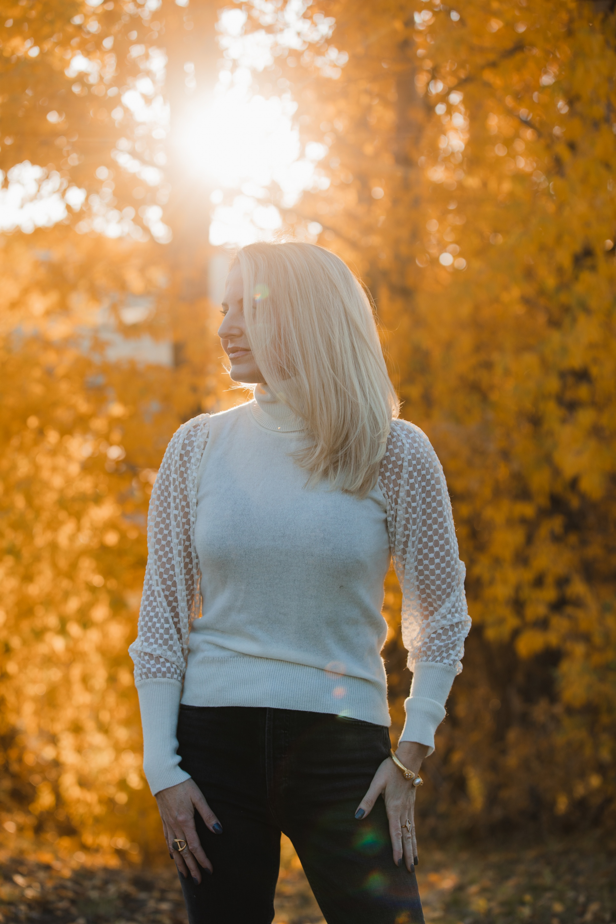Fall sweater, Erin Busbee of Busbee Style wearing an ivory Aqua cashmere turtleneck sweater with mesh sleeves with dark gray jeans by Agolde in Telluride, Colorado