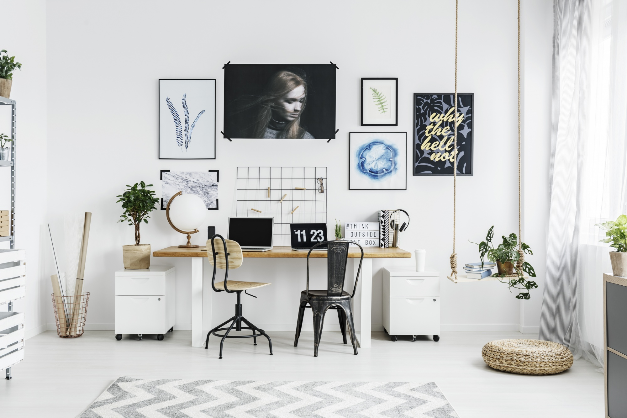 5 Easy Steps To The Perfect and Unique Gallery Wall in an office space with clean lines and neutral tones including a swing used as a planter, posters, art and peg board