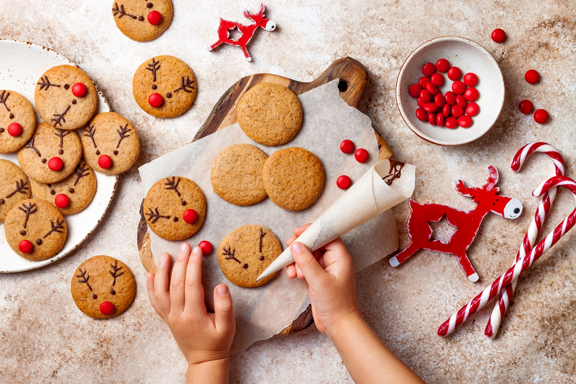 The Best Way To Get Organized Before Holiday Chaos Ensues by remembering to make Christmas traditions a priority like baking reindeer cookies with your kids