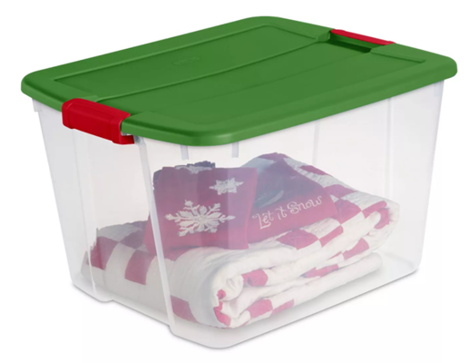 The Best Way To Get Organized Before Holiday Chaos Ensues by using red and green storage bins for all holiday decorations