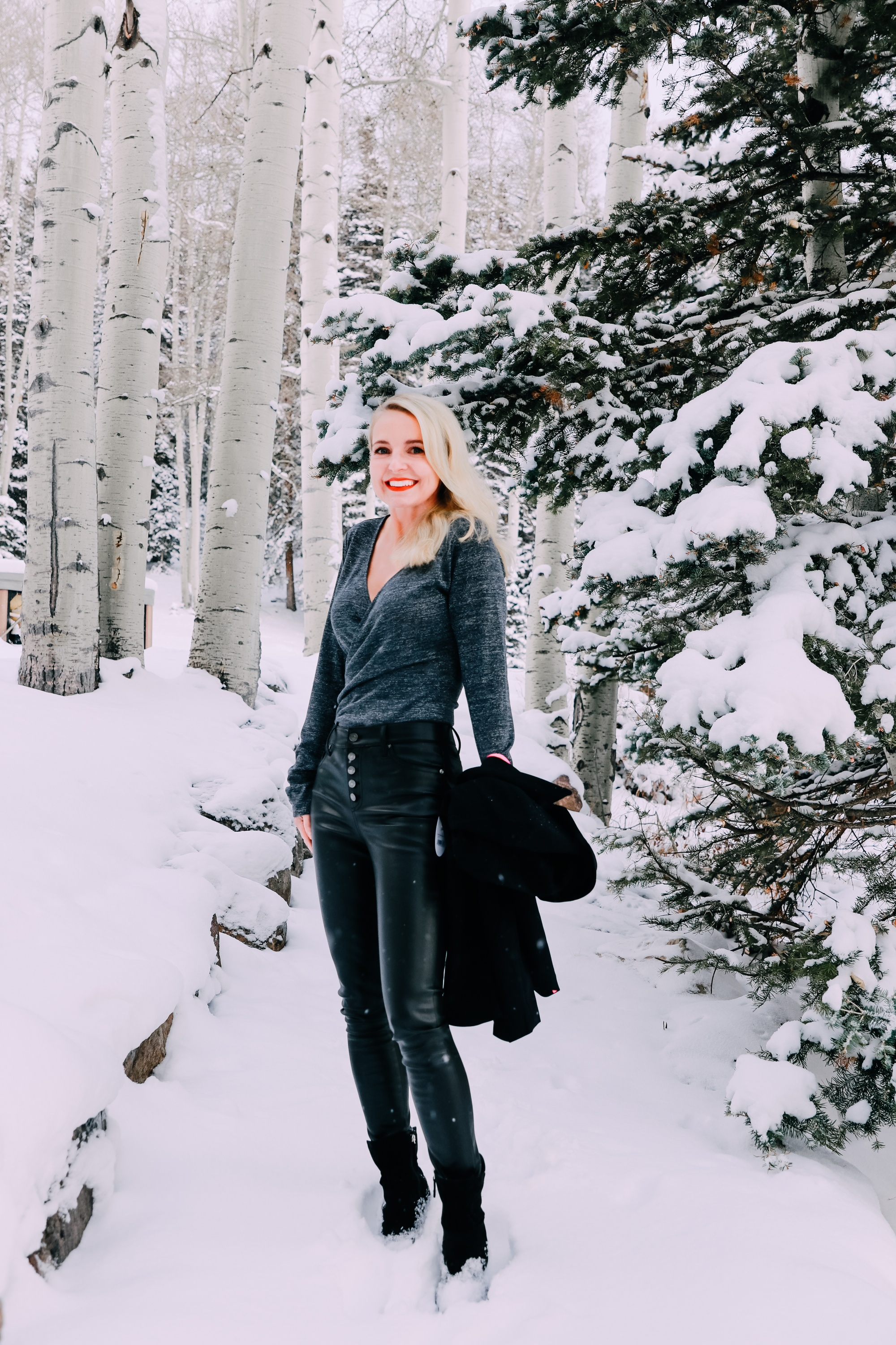 Holiday Party Outfits, Erin Busbee of Busbee Style wearing a black double breasted crepe blazer by Scoop over a metallic wrap style bodysuit but Sofia Vergara with black faux leather high rise skinny jeans by Scoop and black stiletto booties by Scoop in the snow in Telluride, Colorado