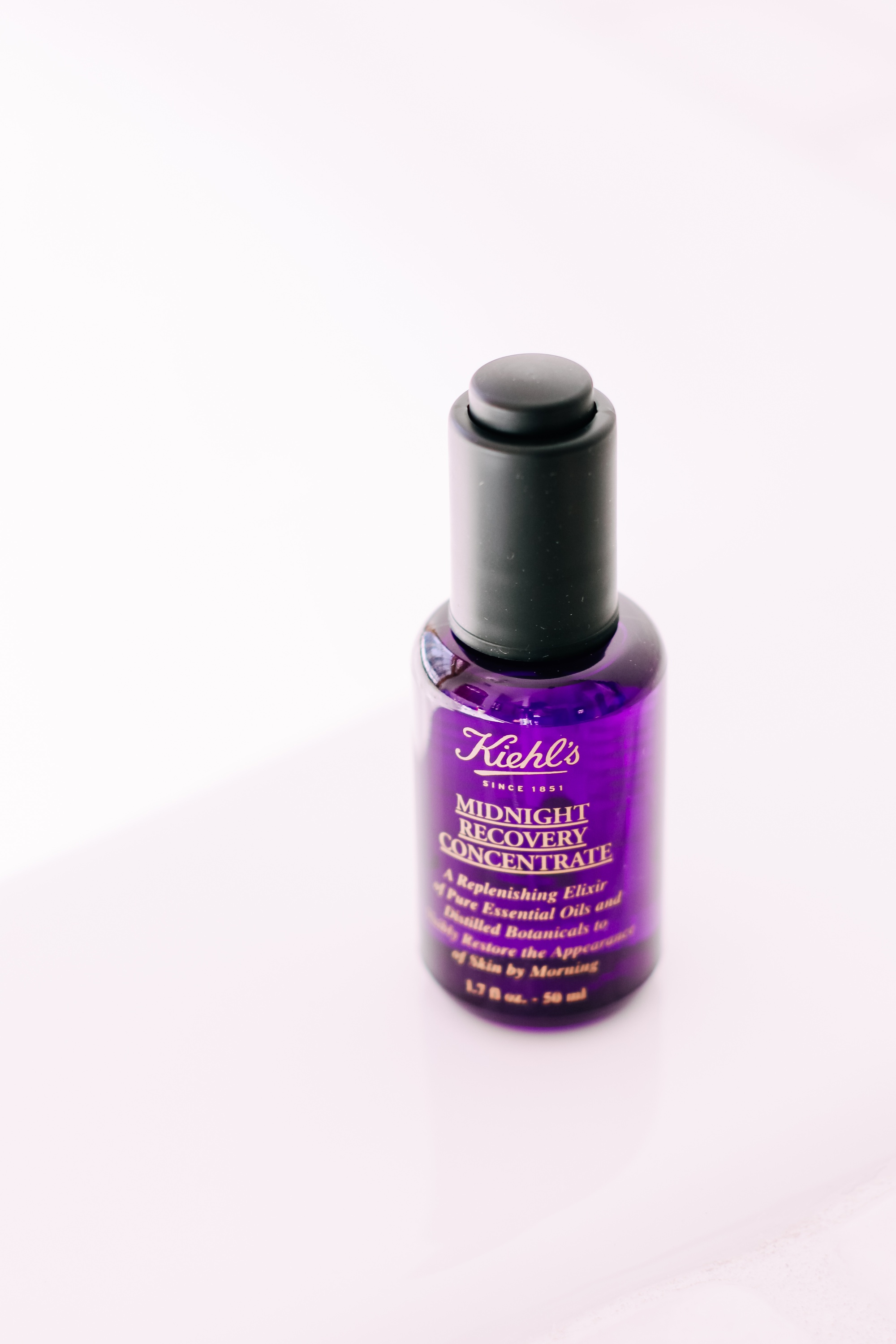 Skincare Gifts, Erin Busbee of Busbee Style using the Midnight Recovery Concentrate Face Oil by Kiehl' in Telluride, Colorado