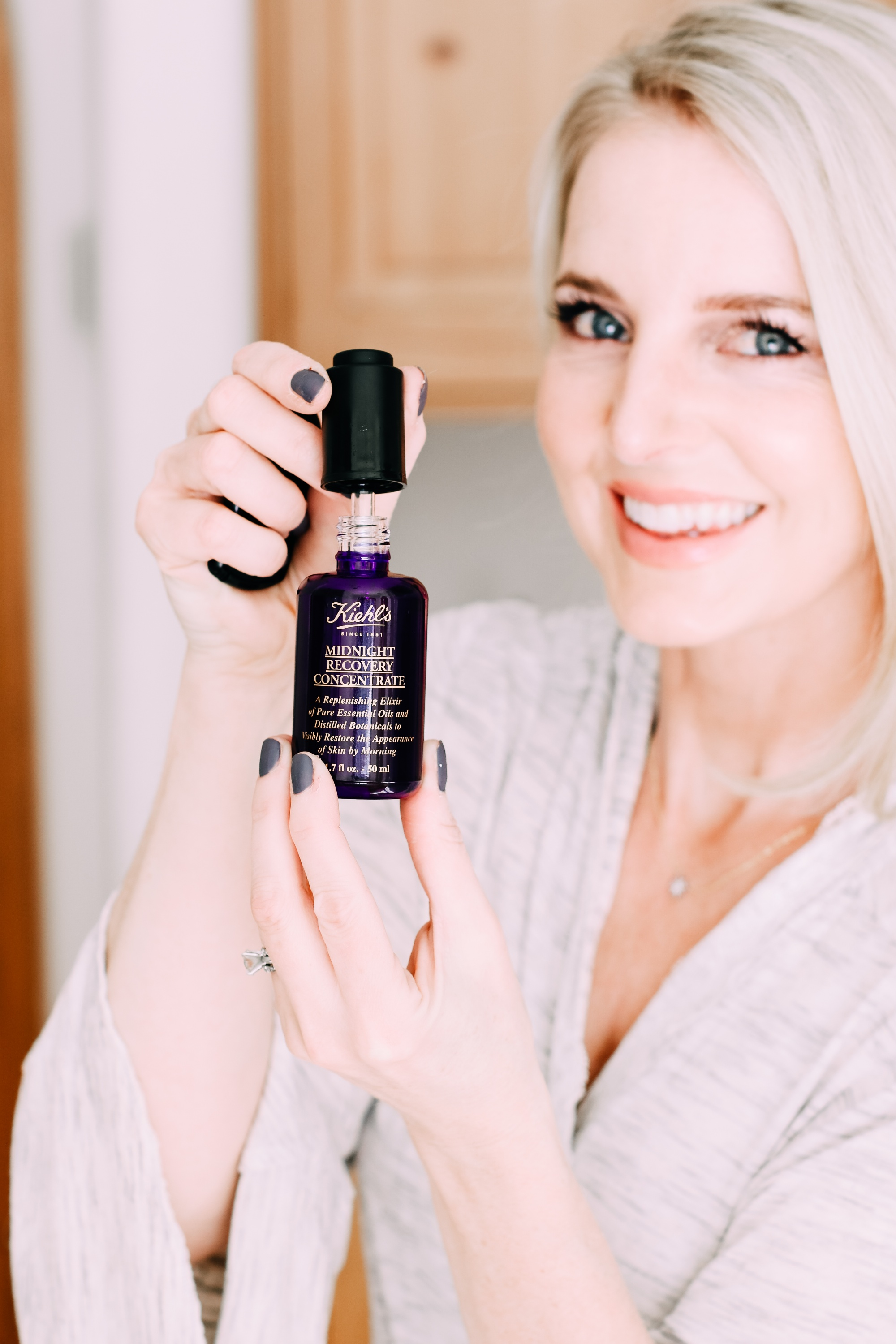 Skincare Gifts, Erin busbee of Busbee Style holding the Midnight Recovery Concentrate Face Oil by Kiehl's from Nordstrom wearing a gray robe in Telluride, Colorado